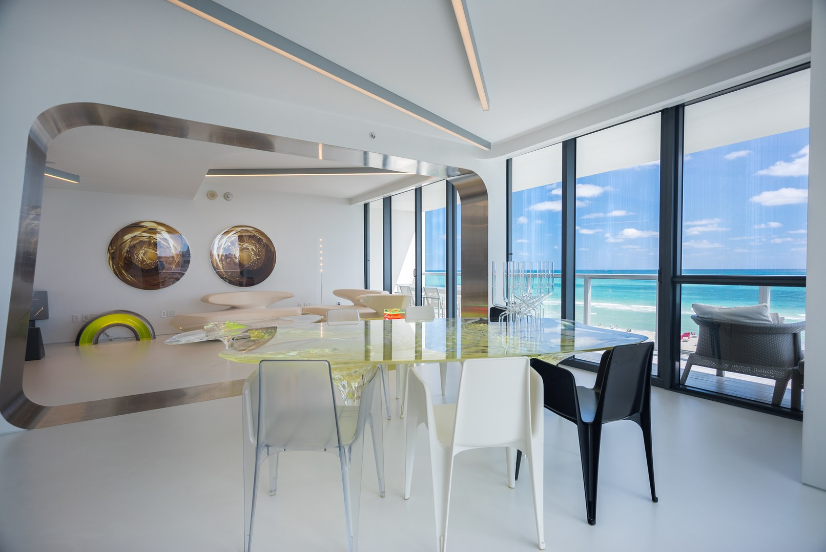 Inside Zaha Hadid's for-sale condo in Miami Beach with the beach and ocean in the distance