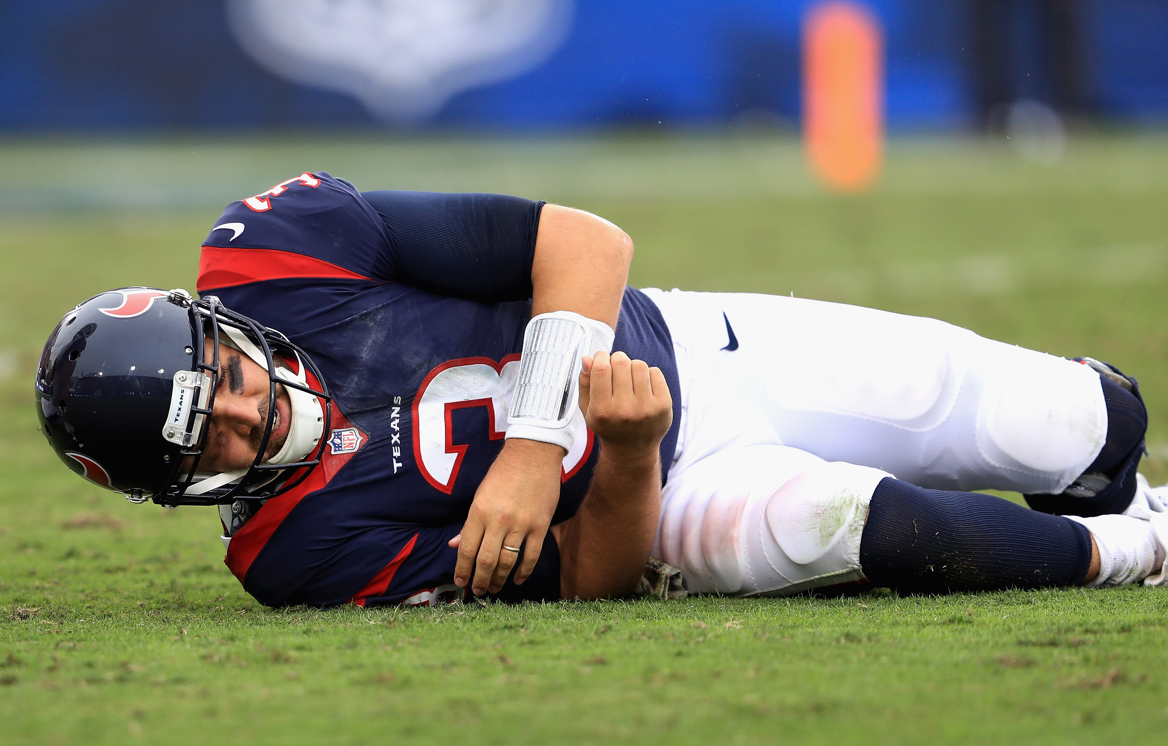 LOS ANGELES, CA - NOVEMBER 12:  Tom Savage #3 of the Houston Texans grimaces on the turf after fumbling the ball during the second half of game against the Los Angeles Rams  at Los Angeles Memorial Coliseum on November 12, 2017 in Los Angeles, California.  (Photo by Sean M. Haffey/Getty Images)