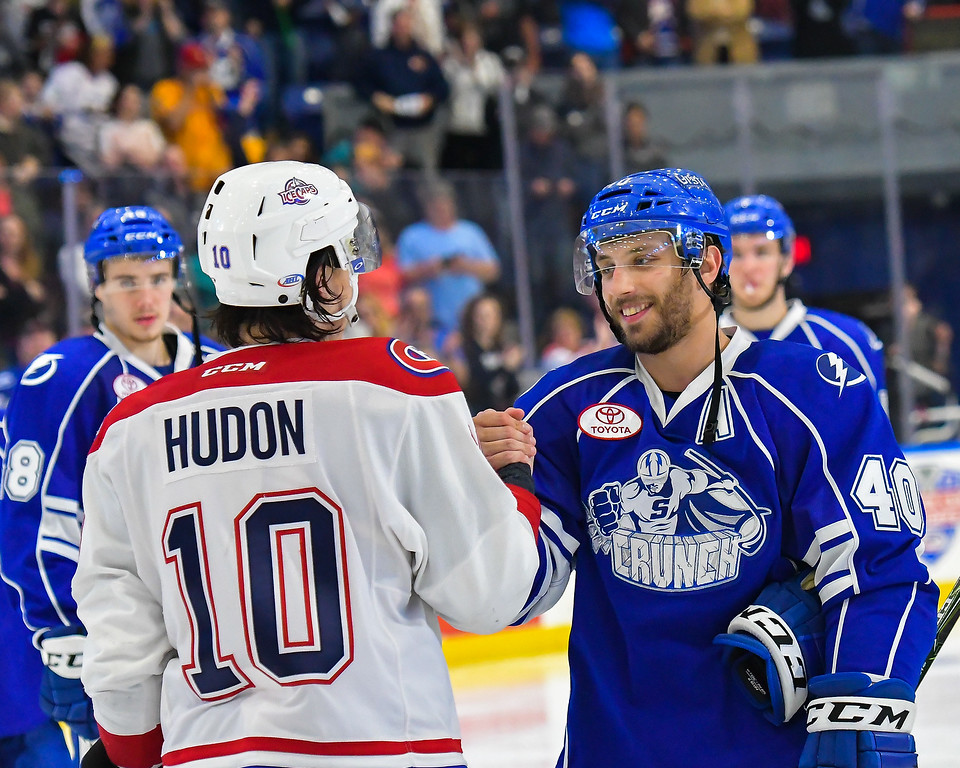 Syracuse Crunch Gabriel Dumont (40) shakes hands with St. John's Ice Caps Charles Hudon (10) after the Crunch clinched the series over the Ice Caps in an American Hockey League (AHL) Calder Cup Playoff game at the War Memorial Arena in Syracuse, New York on Friday, April 28, 2017. Syracuse won 2-1 in overtime.