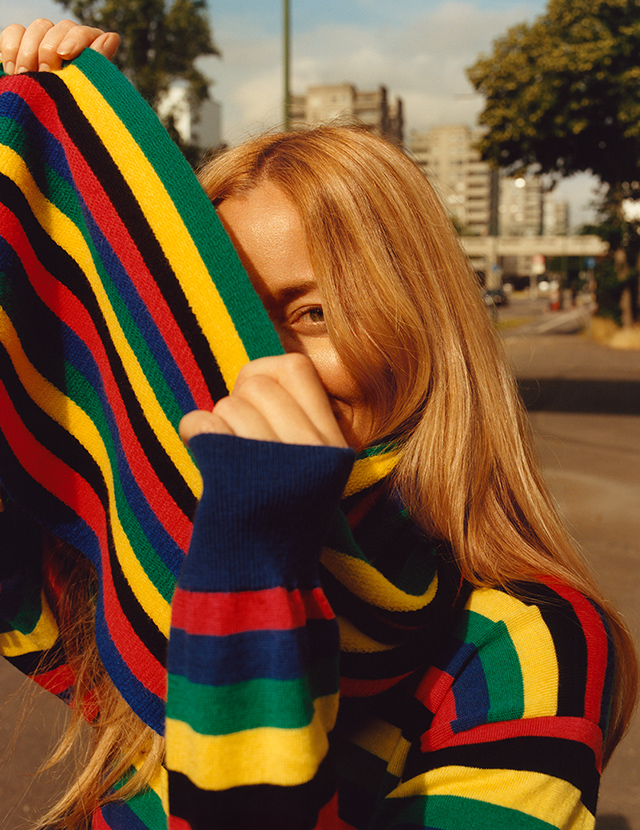 A model wearing a brightly colored scarf