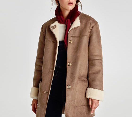 A model wearing a faux suede and shearling coat
