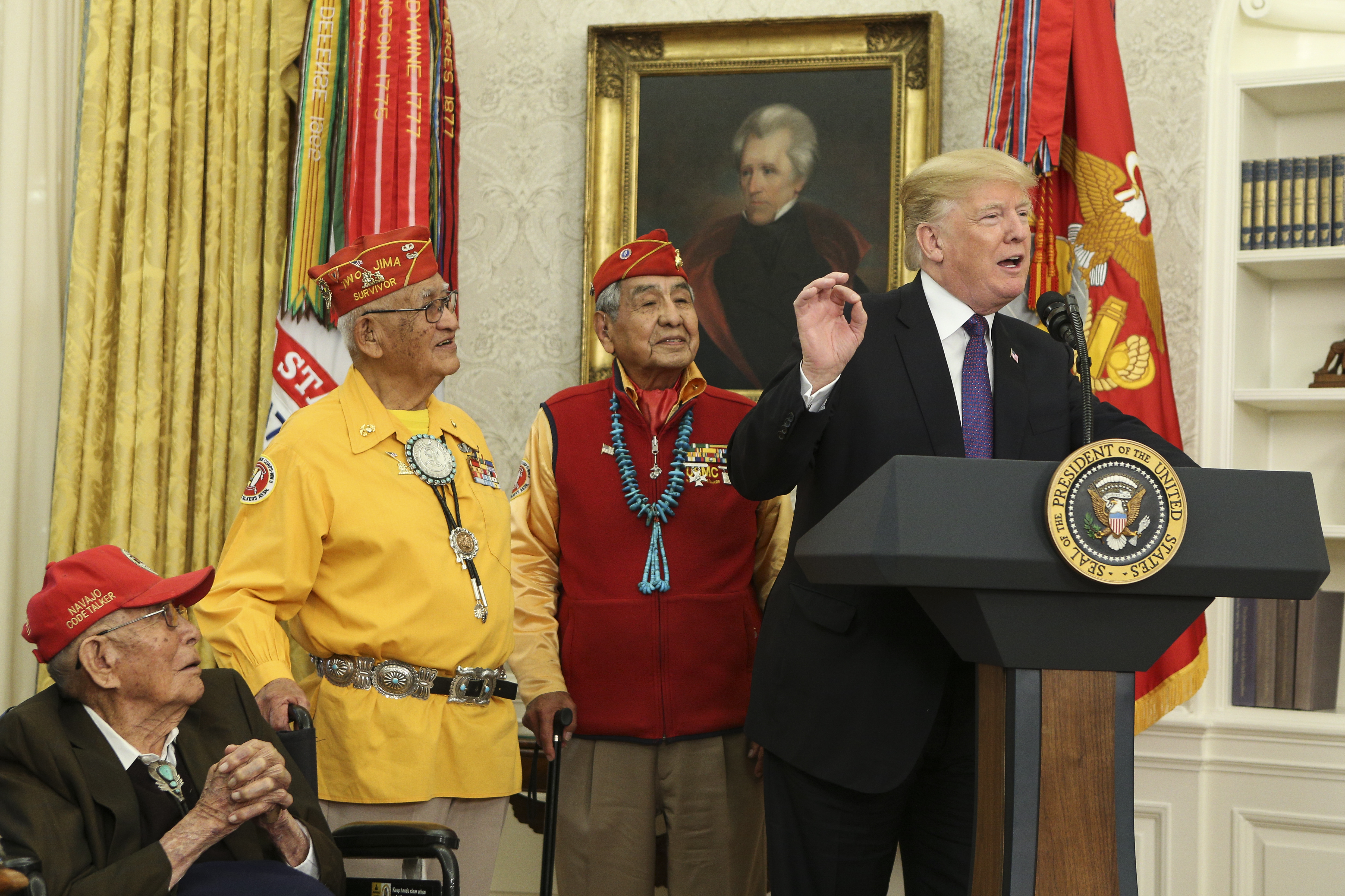WASHINGTON, DC - NOVEMBER 27: (AFP OUT) U.S. President Donald Trump (R) speaks during an event honoring members of the Native American code talkers in the Oval Office of the White House, on November 27, 2017 in Washington, DC. Trump stated, 'You were here long before any of us were here. Although we have a representative in Congress who they say was here a long time ago. They call her Pocahontas.' in reference to his nickname for Sen. Elizabeth Warren. (Photo by Oliver Contreras-Pool/Getty Images)