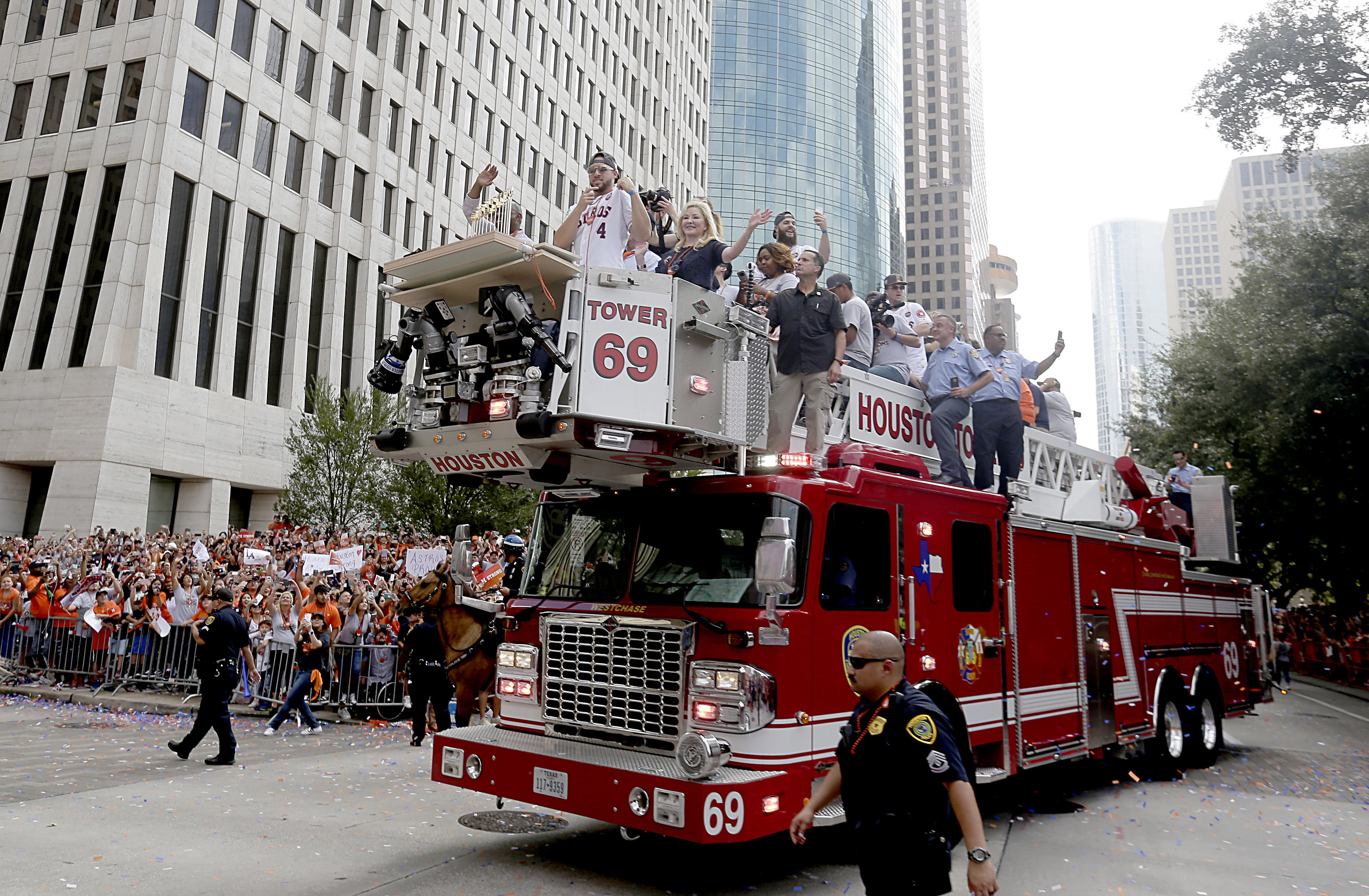 Nov 3, 2017; Houston, TX, USA; Houston Astros center fielder George Springer (4) leads the way on a fire engine truck during the World Series championship parade and rally for the Houston Astros in downtown on Smith St. Mandatory Credit: Thomas B. Shea-USA TODAY Sports