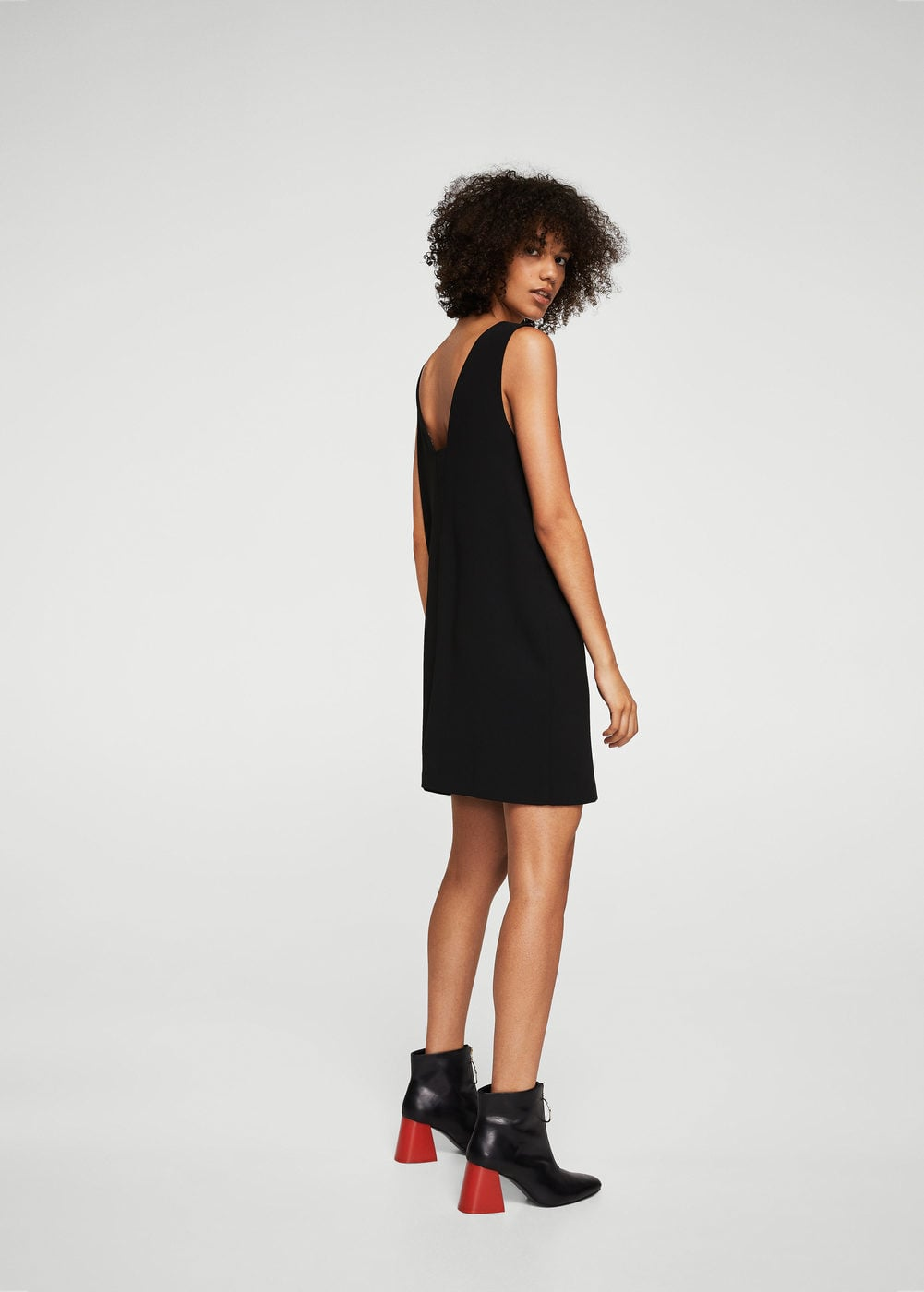 A woman in a black dress from Mango