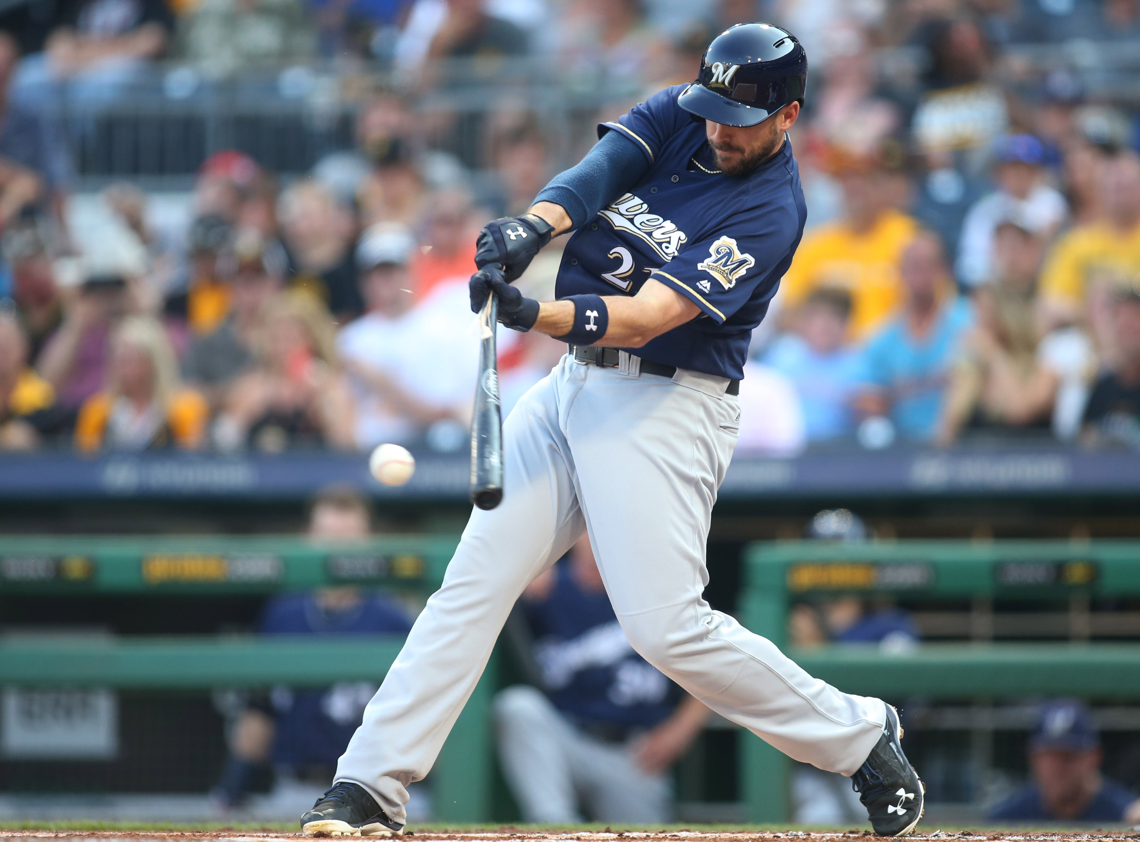 Jul 19, 2017; Pittsburgh, PA, USA;  Milwaukee Brewers third baseman Travis Shaw (21) singles against the Pittsburgh Pirates during the first inning at PNC Park. Mandatory Credit: Charles LeClaire-USA TODAY Sports