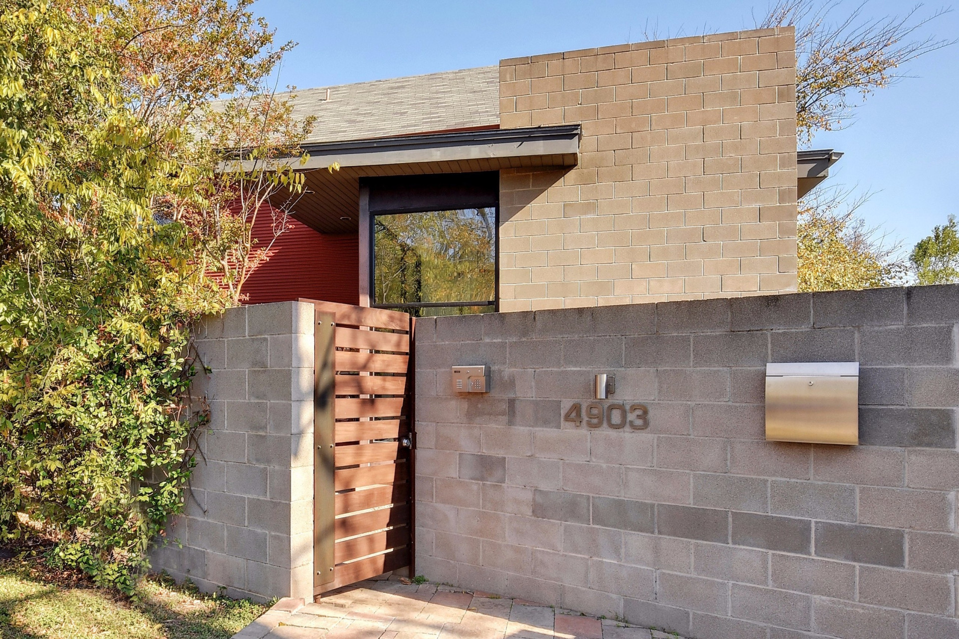 Photo of contemporary home with cinderblock half-wall in front