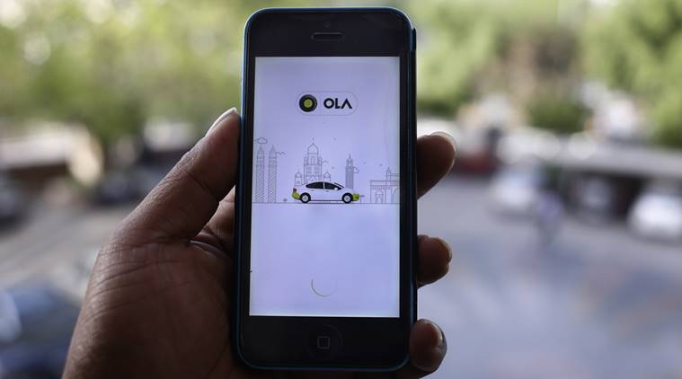 A mobile phone displaying the Ola app