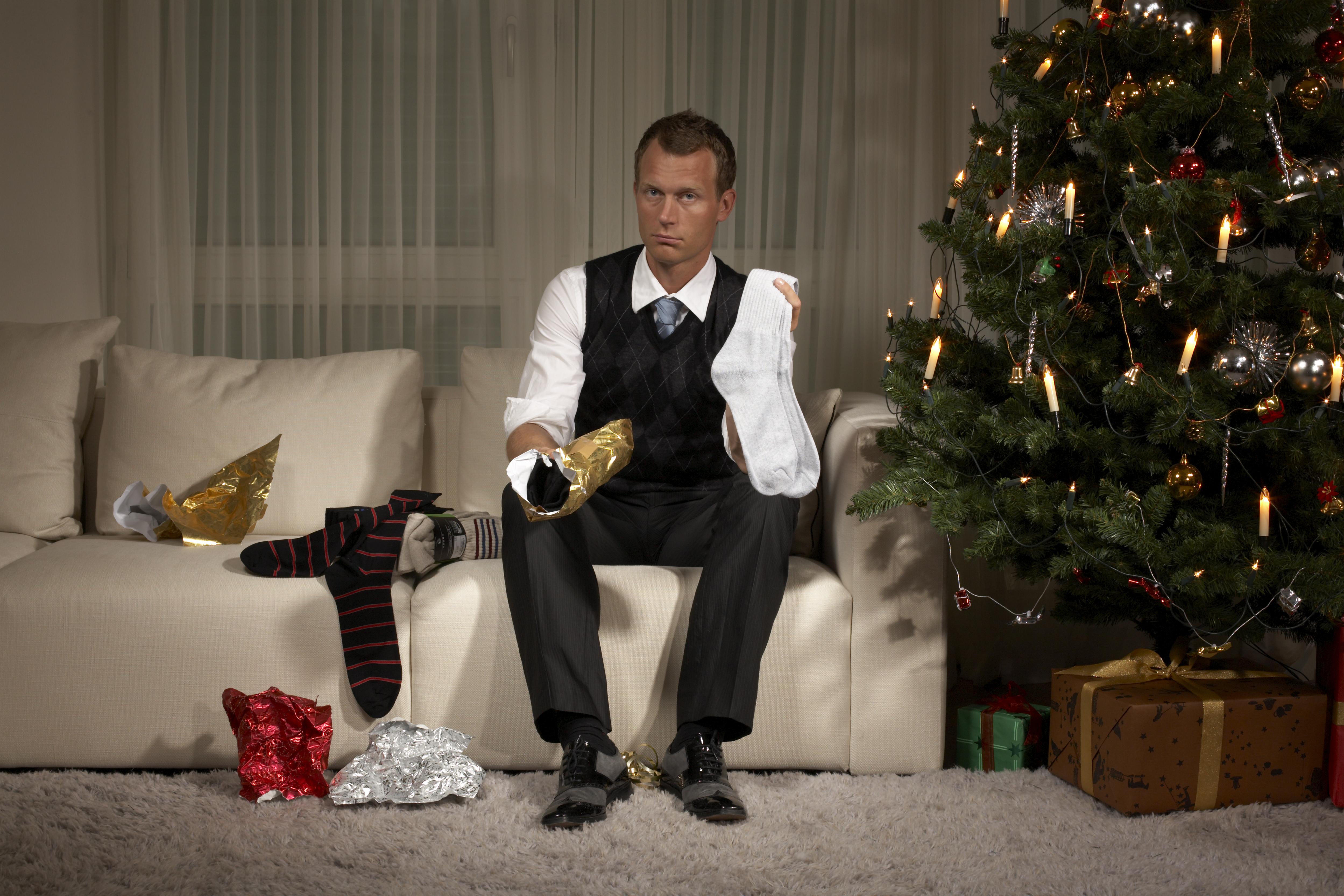 A man receiving socks at Christmas