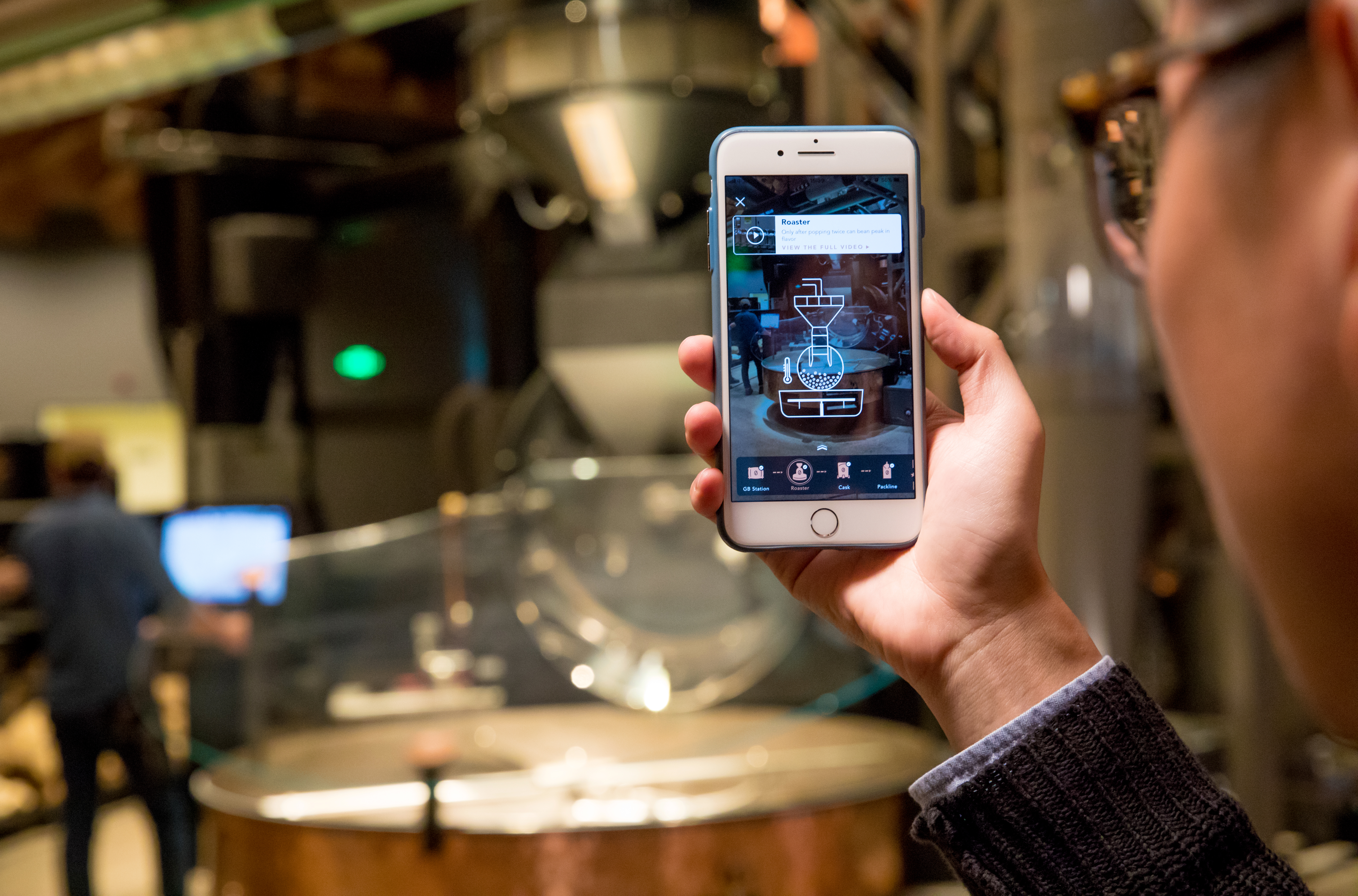 A customer uses the augmented reality feature at the Shanghai Roastery.
