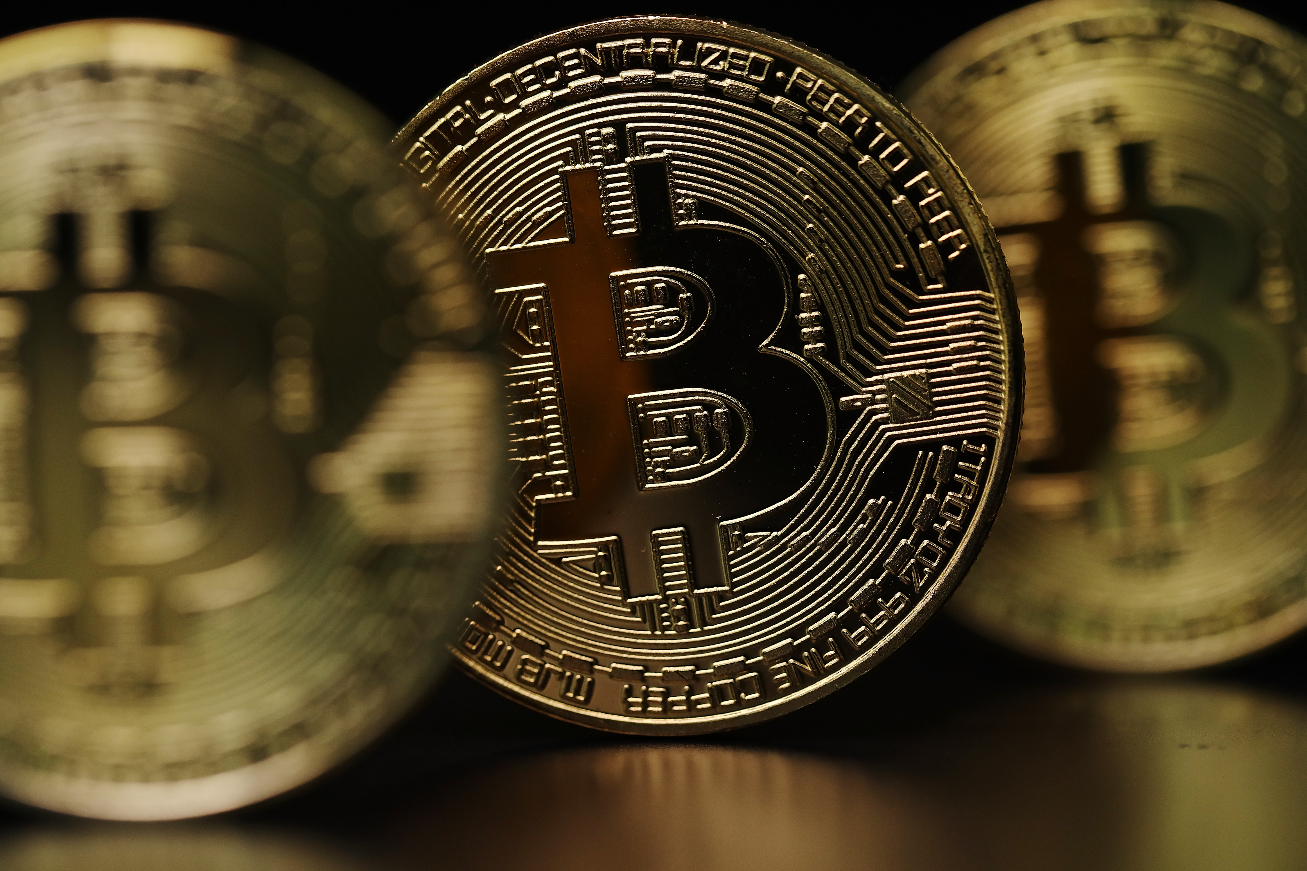 A bitcoin symbol —a combination of a capital B and a dollar sign — on a gold coin