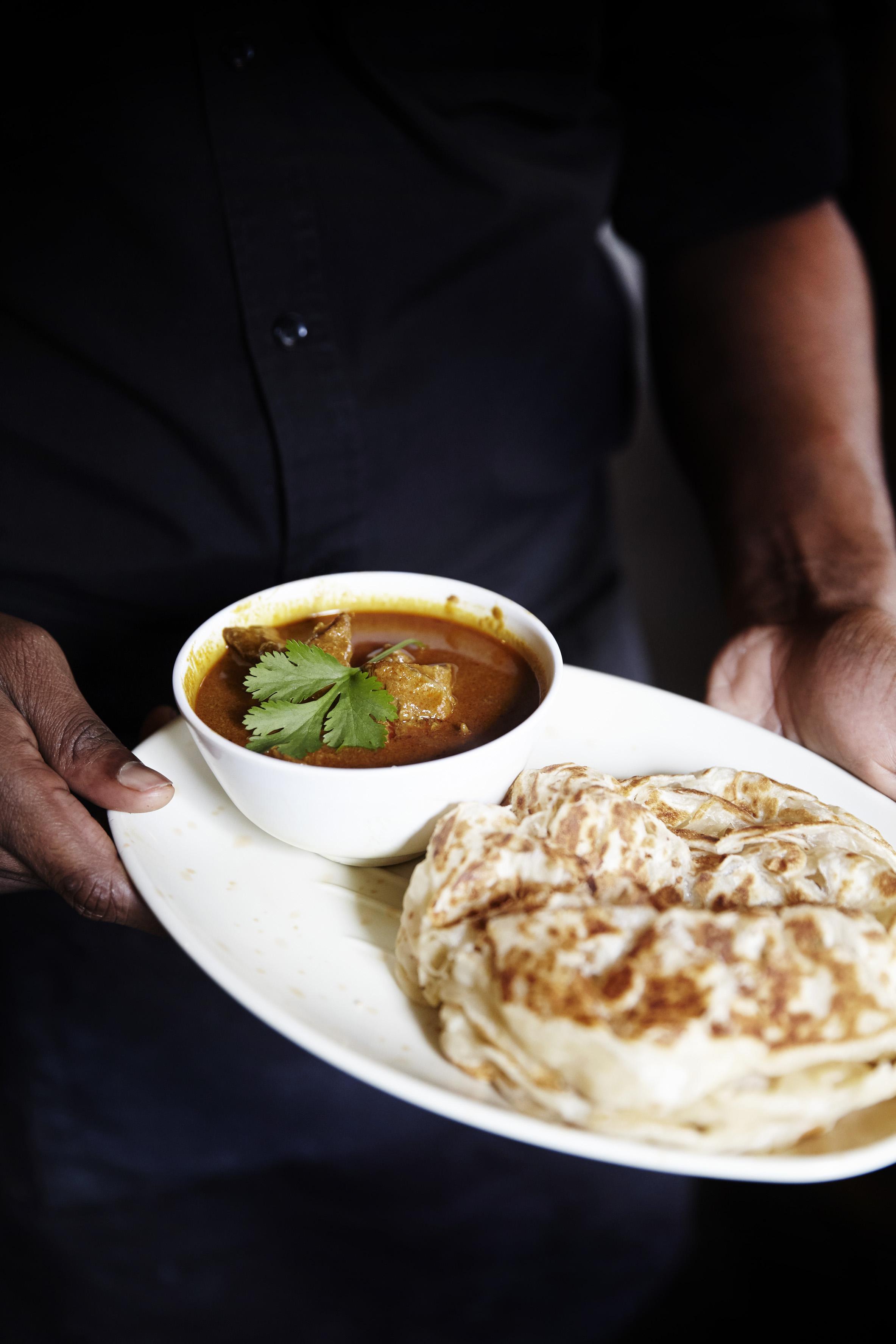 roti canai and daal at Roti King, a classic London restaurant