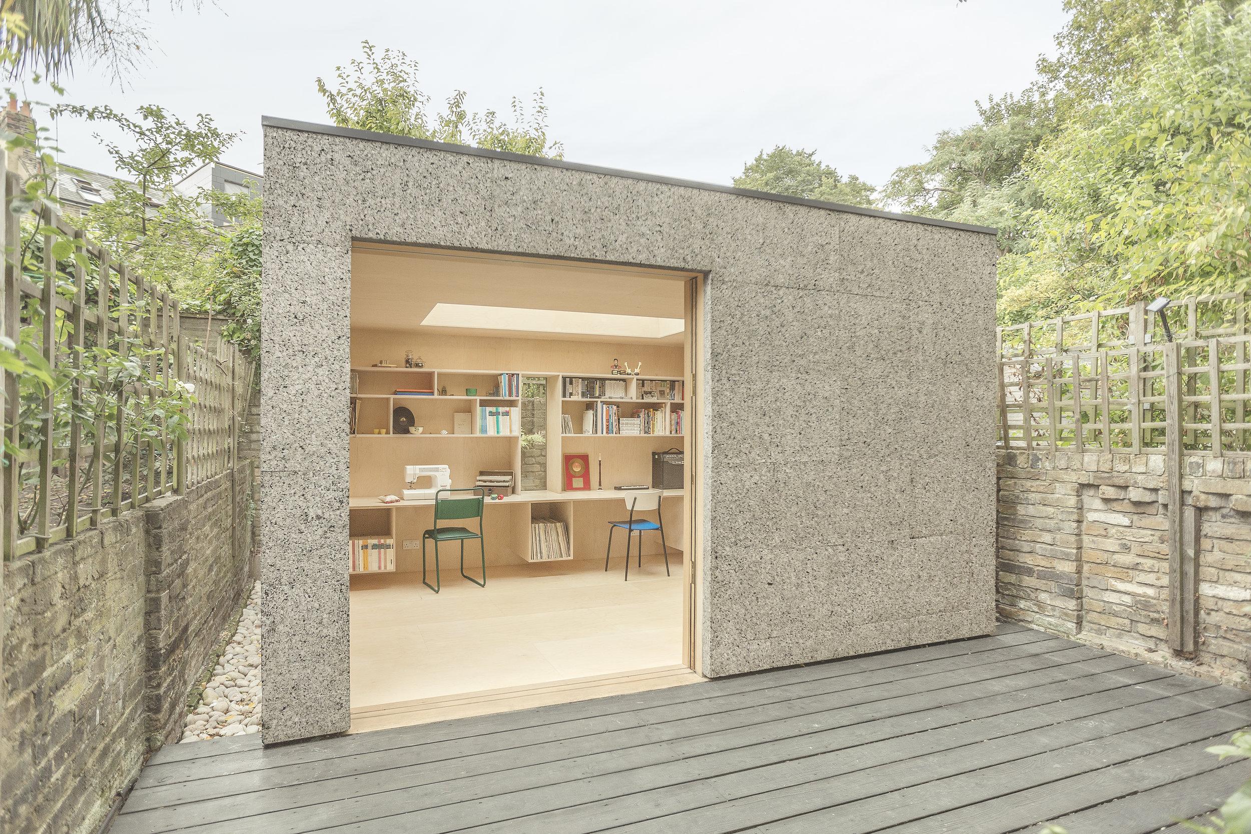 cork-covered backyard studio
