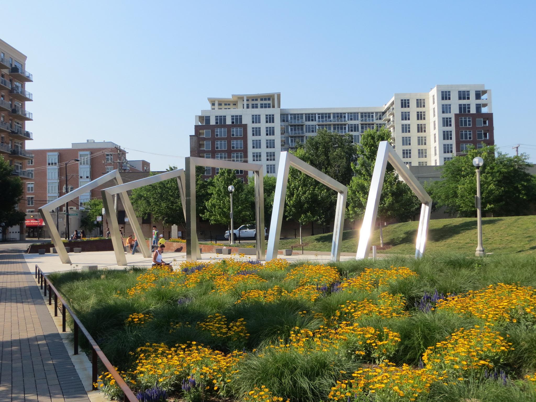 Retangular, frame-shaped public art in Chicago's Mary Bartelme Park on a sunny day.