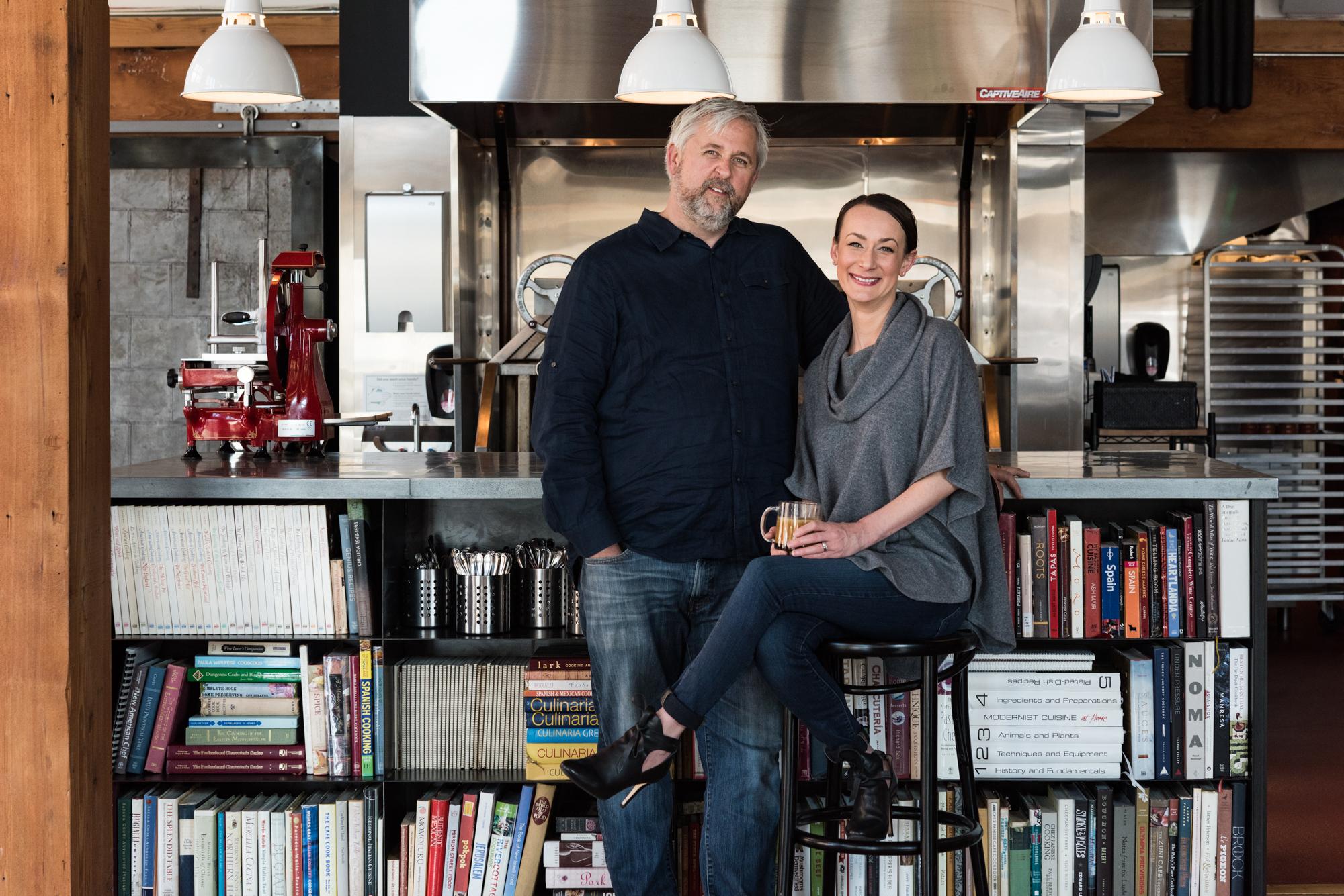 John Gorham stands next to Renee Gorham at the chef's pass
