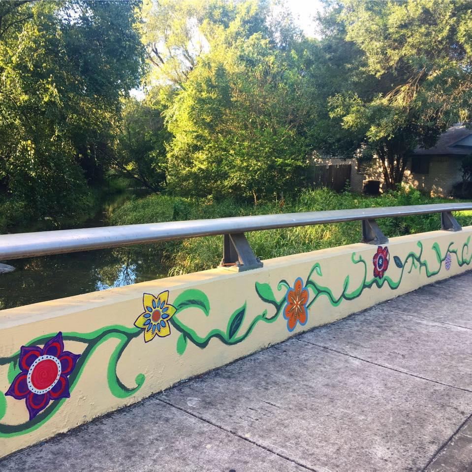 Short concrete bridge with mural of flowers