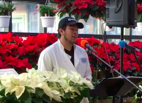 Russo's employee Gilly Assuncao singing