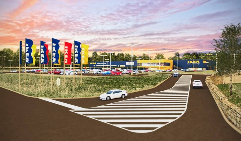 A simple drawing of a driveway and parking lot with a large blue IKEA store.