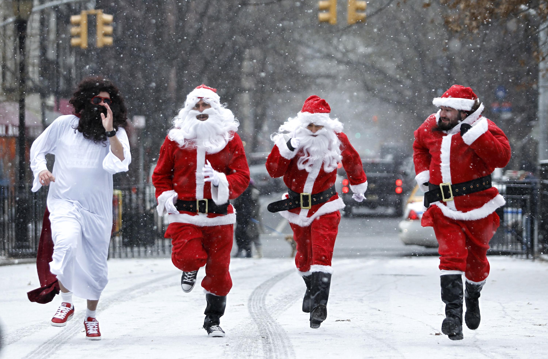Revelers Dressed As Santa Take Part In Annual Bar Crawl Thru NYC