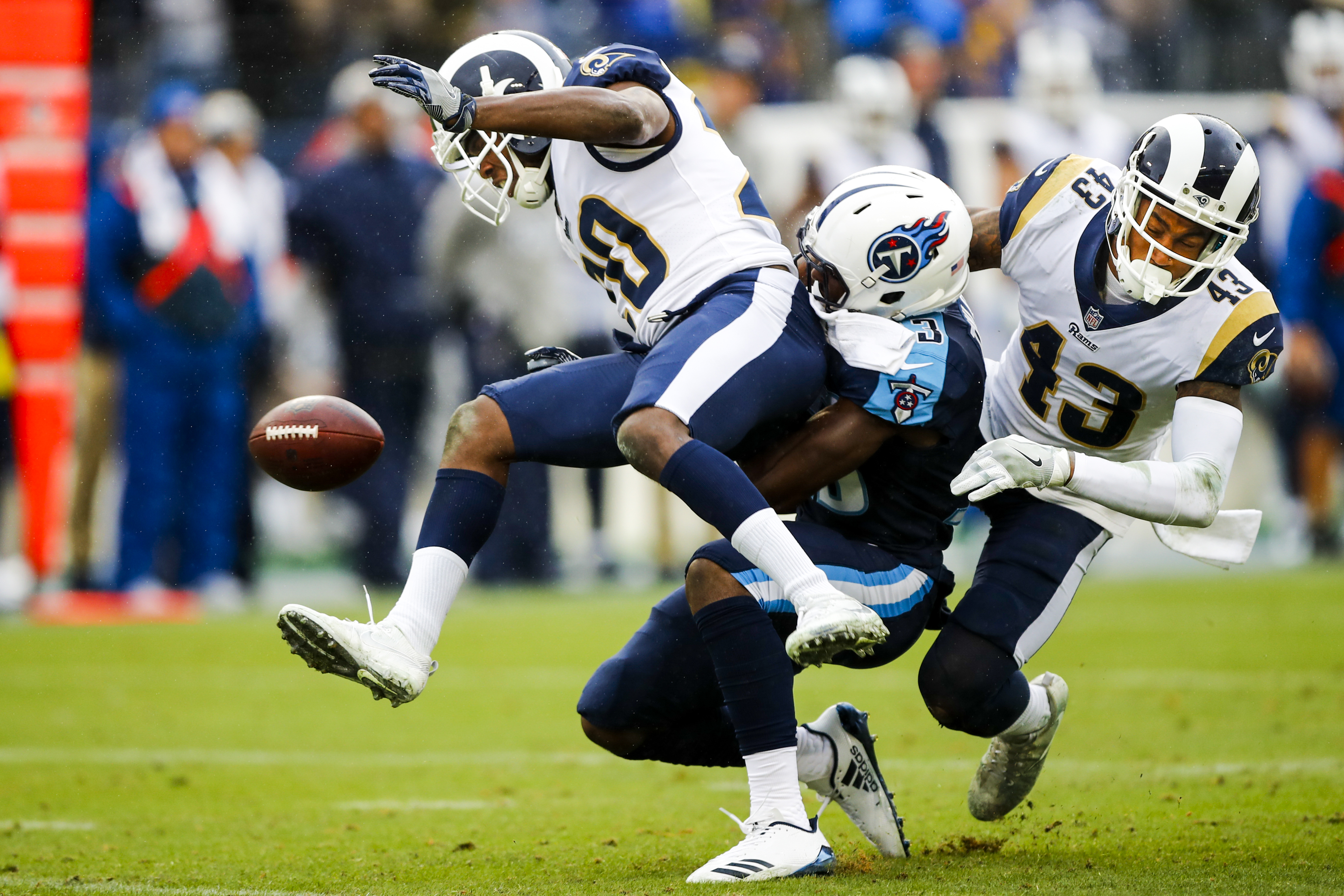 A pass to Tennessee Titans WR Taywan Taylor is broken up by Los Angeles Rams S Lamarcus Joyner & S John Johnson
