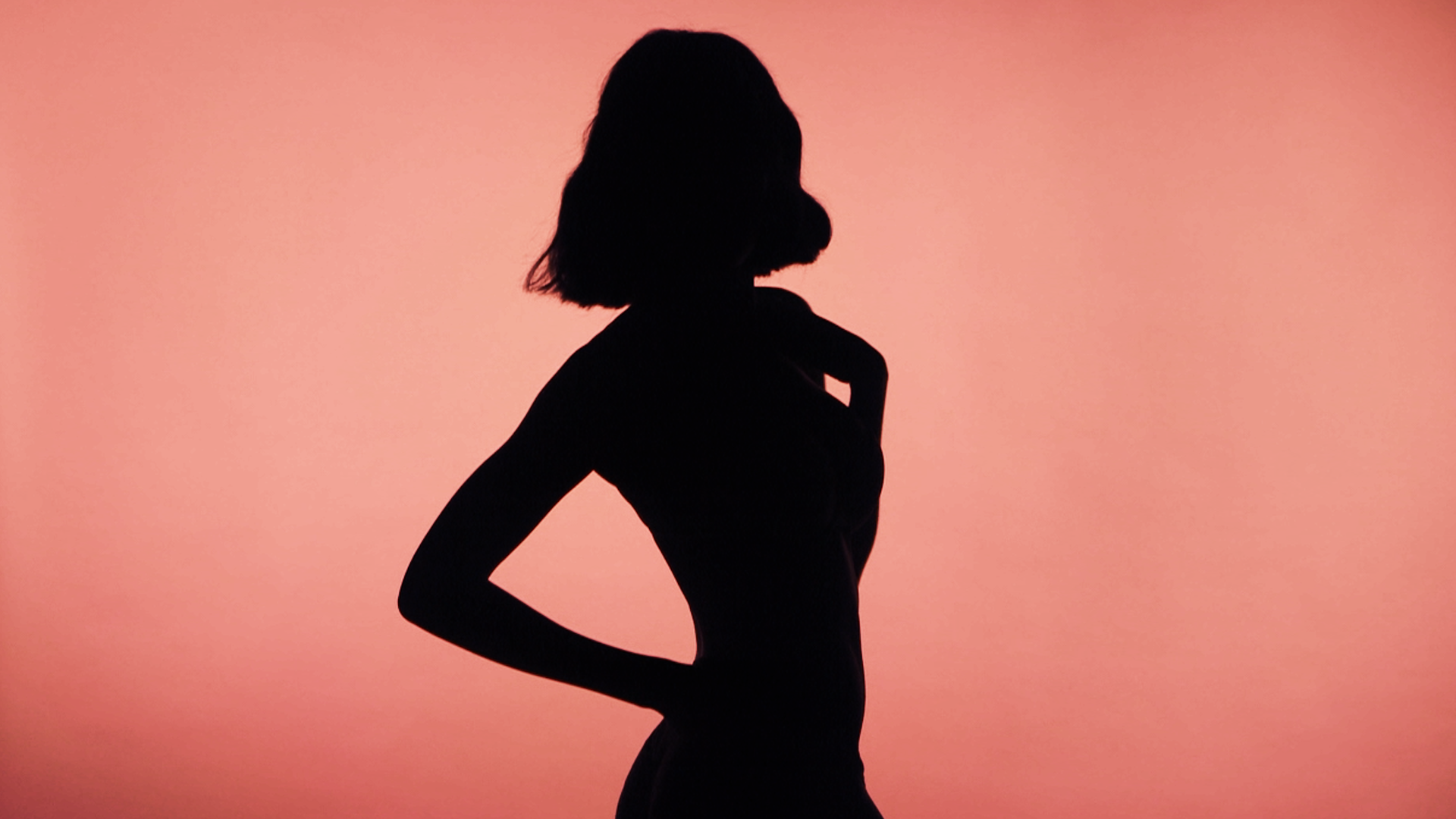 Silhouette of woman on pink background