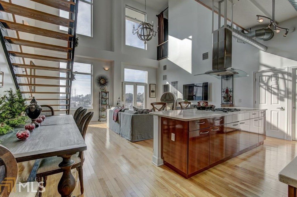The main living space of a Buckhead loft for sale near Chastain Park.