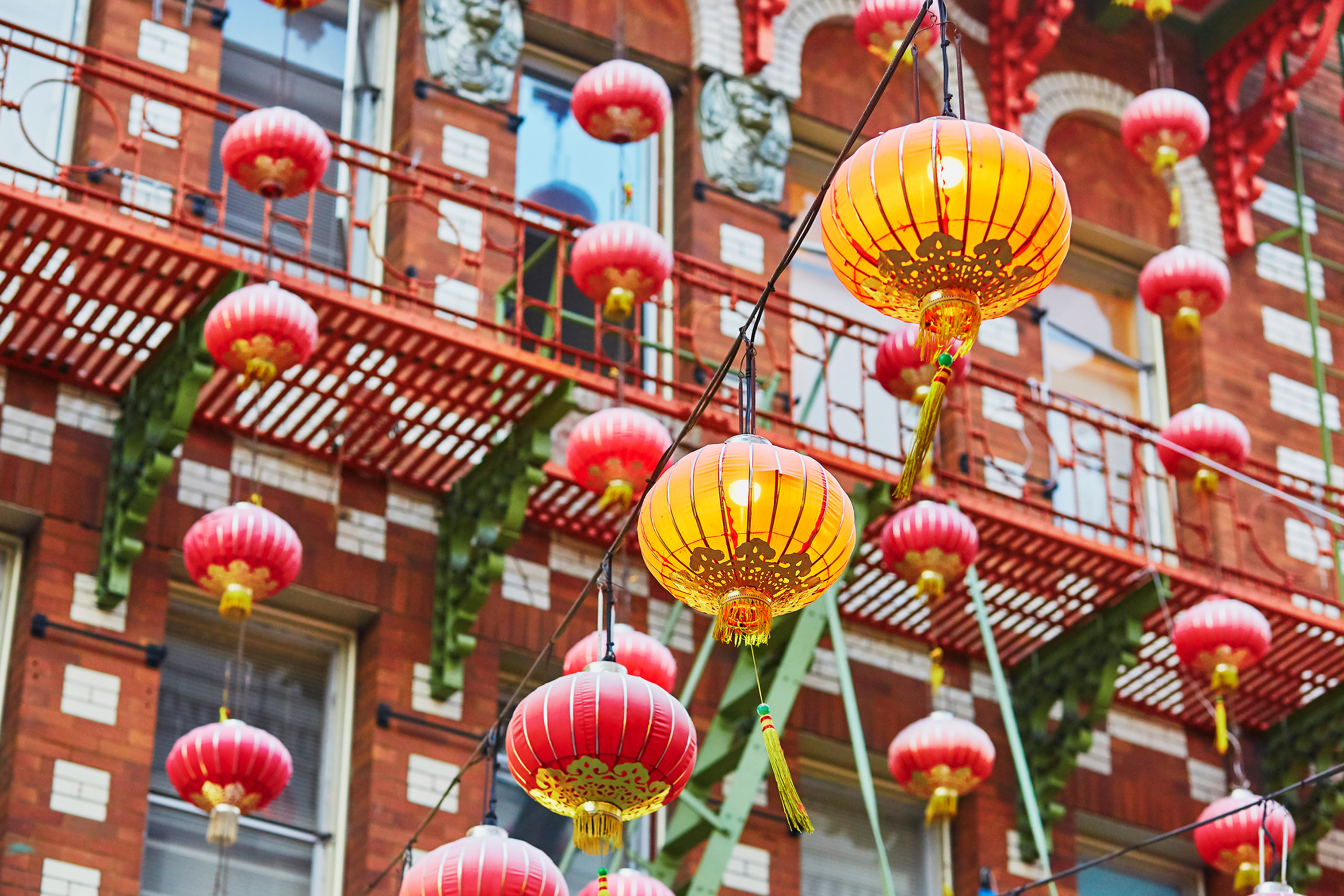 A photo of red lanterns against a building in Chinatown