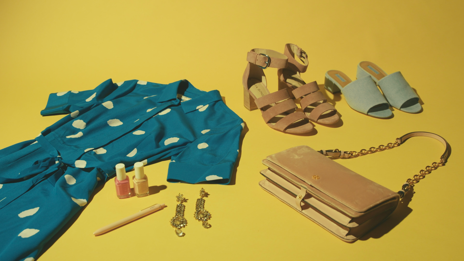 A flat lay of clothes, shoes, and accessories