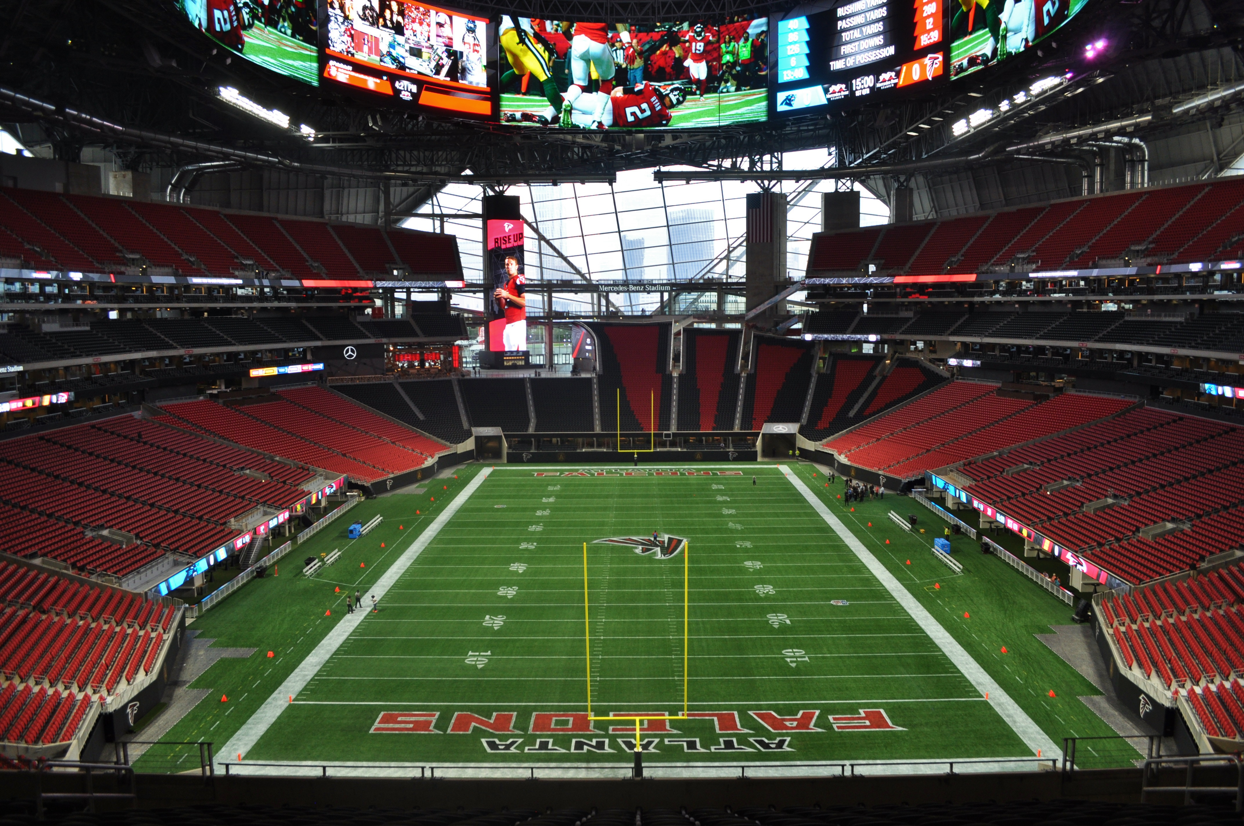A picture from the west endzone at the middle level of the stadium, looking down the field and out the massive window to downtown.