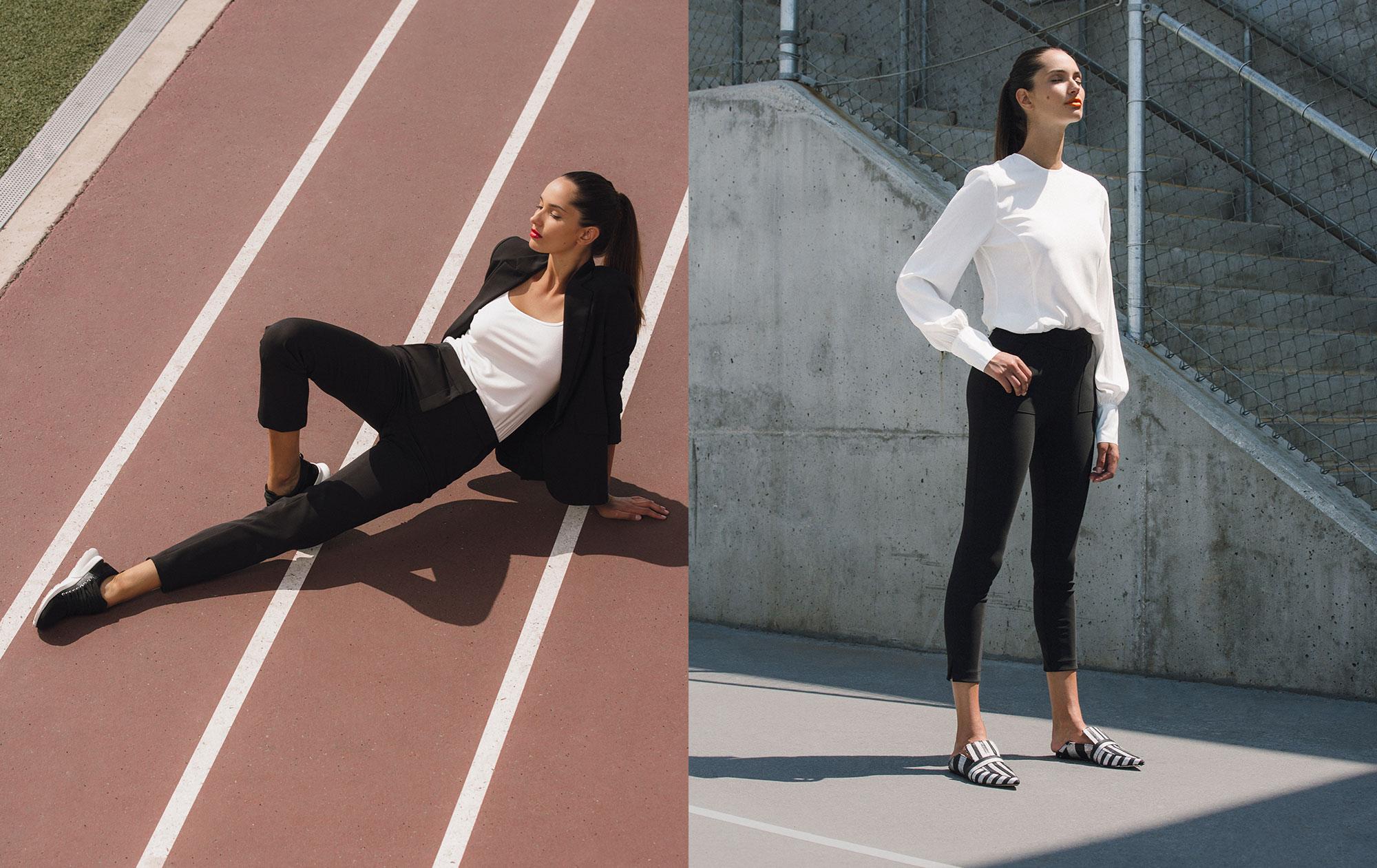 A model wearing Aella pants on a track field