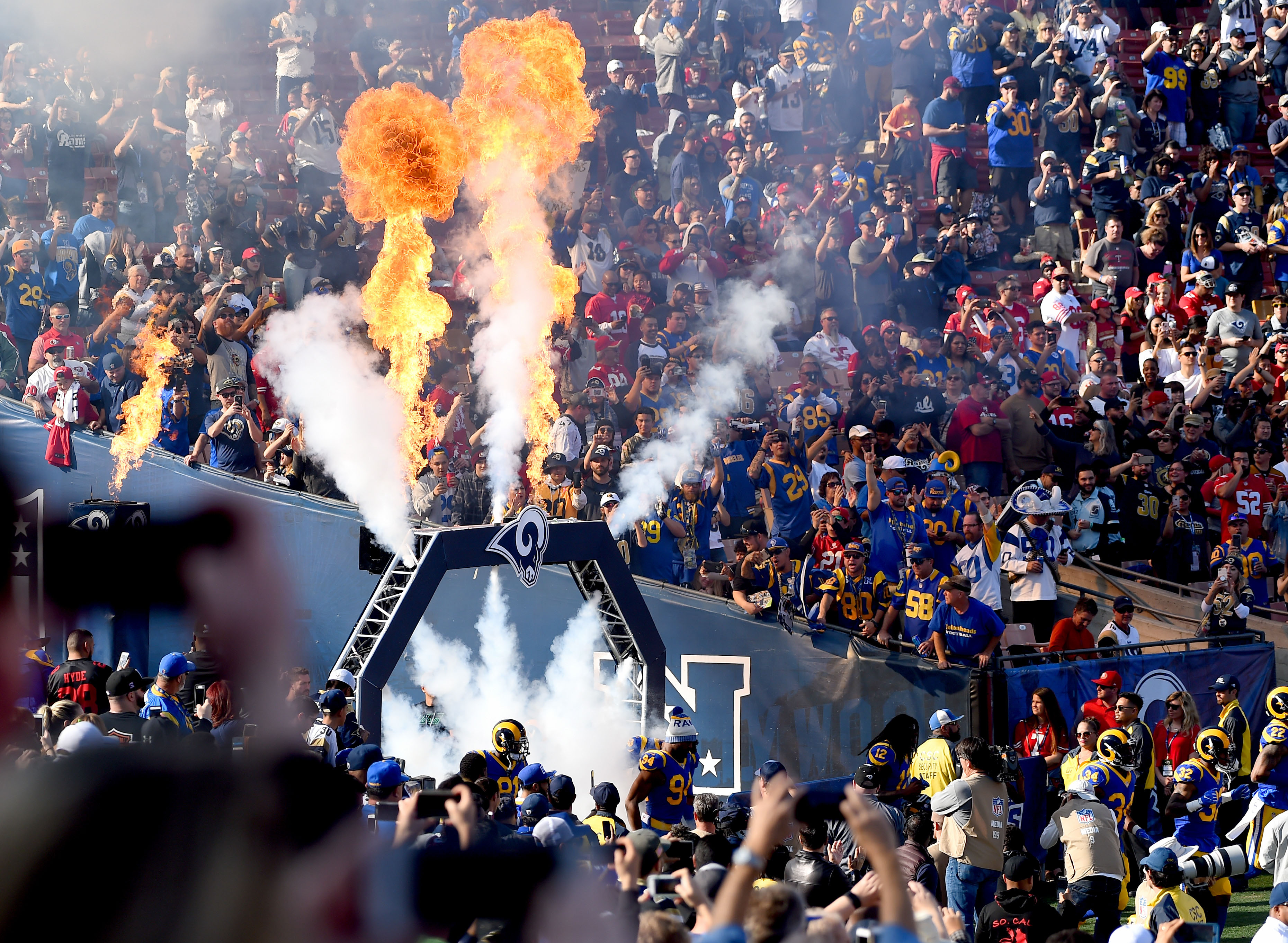 Los Angeles Rams players enter the field against the San Francisco 49ers in Week 17 at the Los Angeles Memorial Coliseum