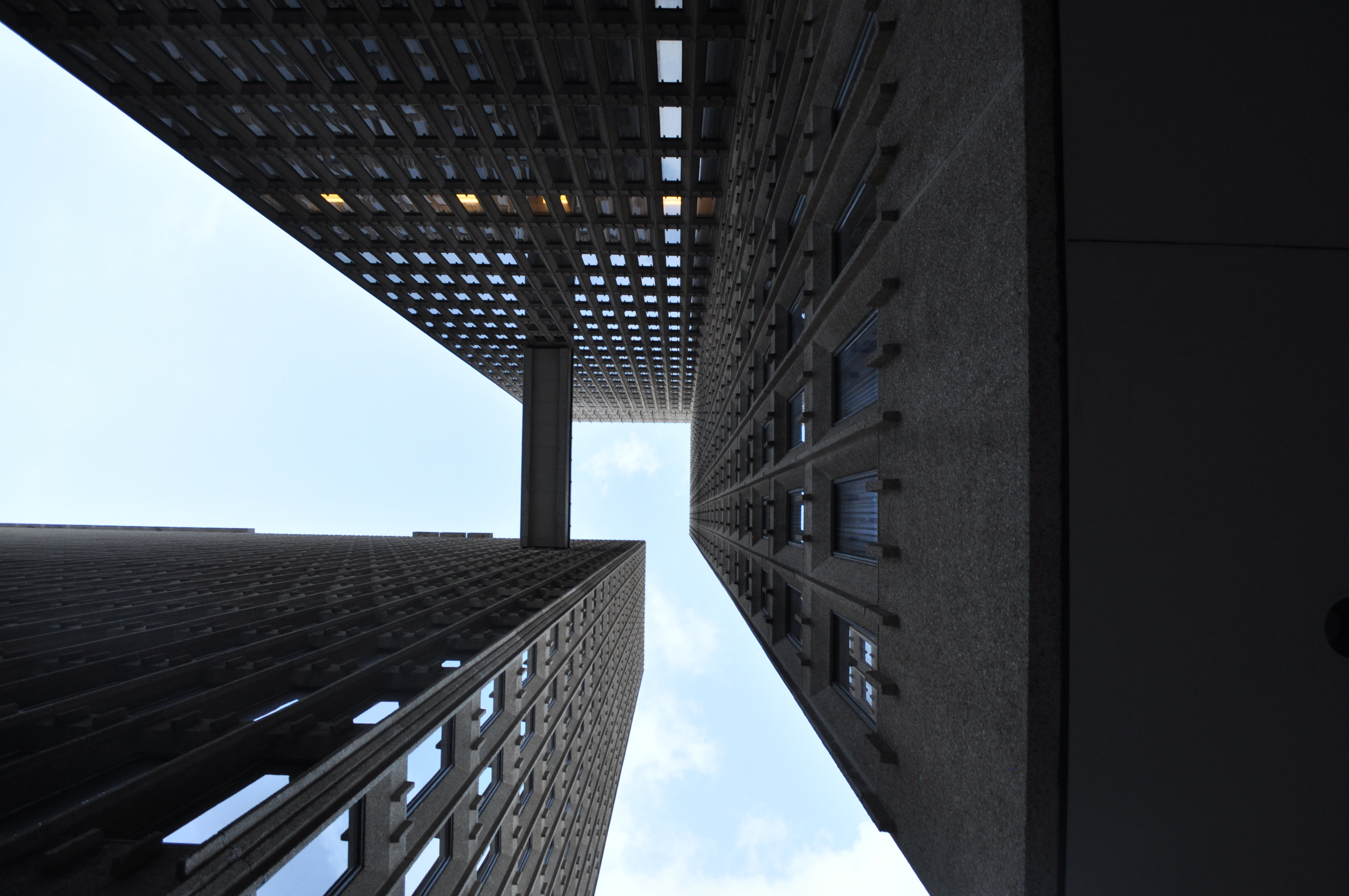 Looking up to the buildings and a skybridge.