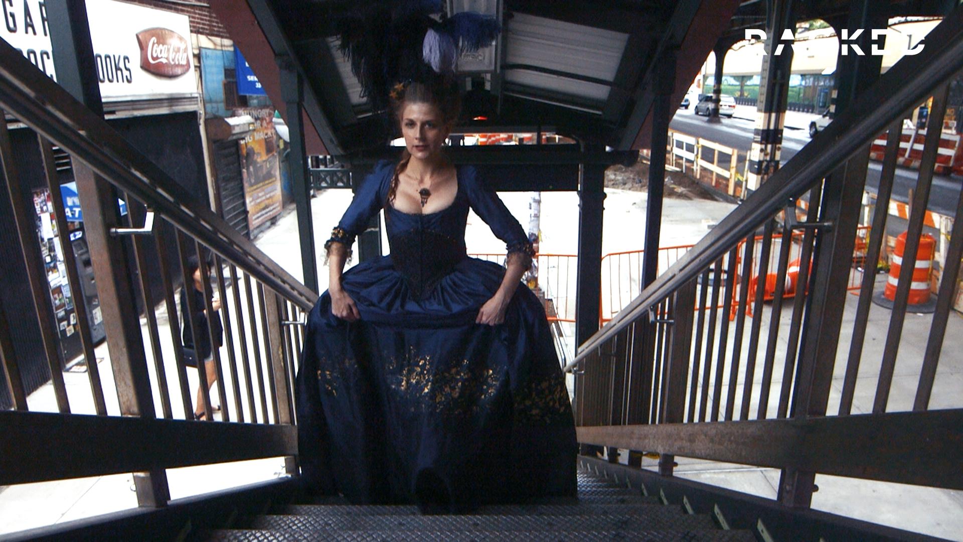 Lauren Rossi walking up subway stairs