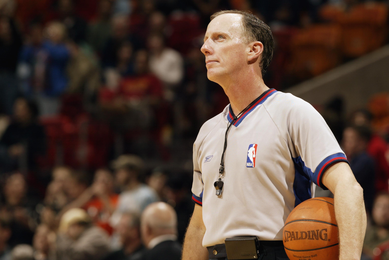 Referee Don Vaden look on