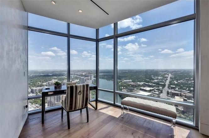 Corner of condo with views overlooking river and city