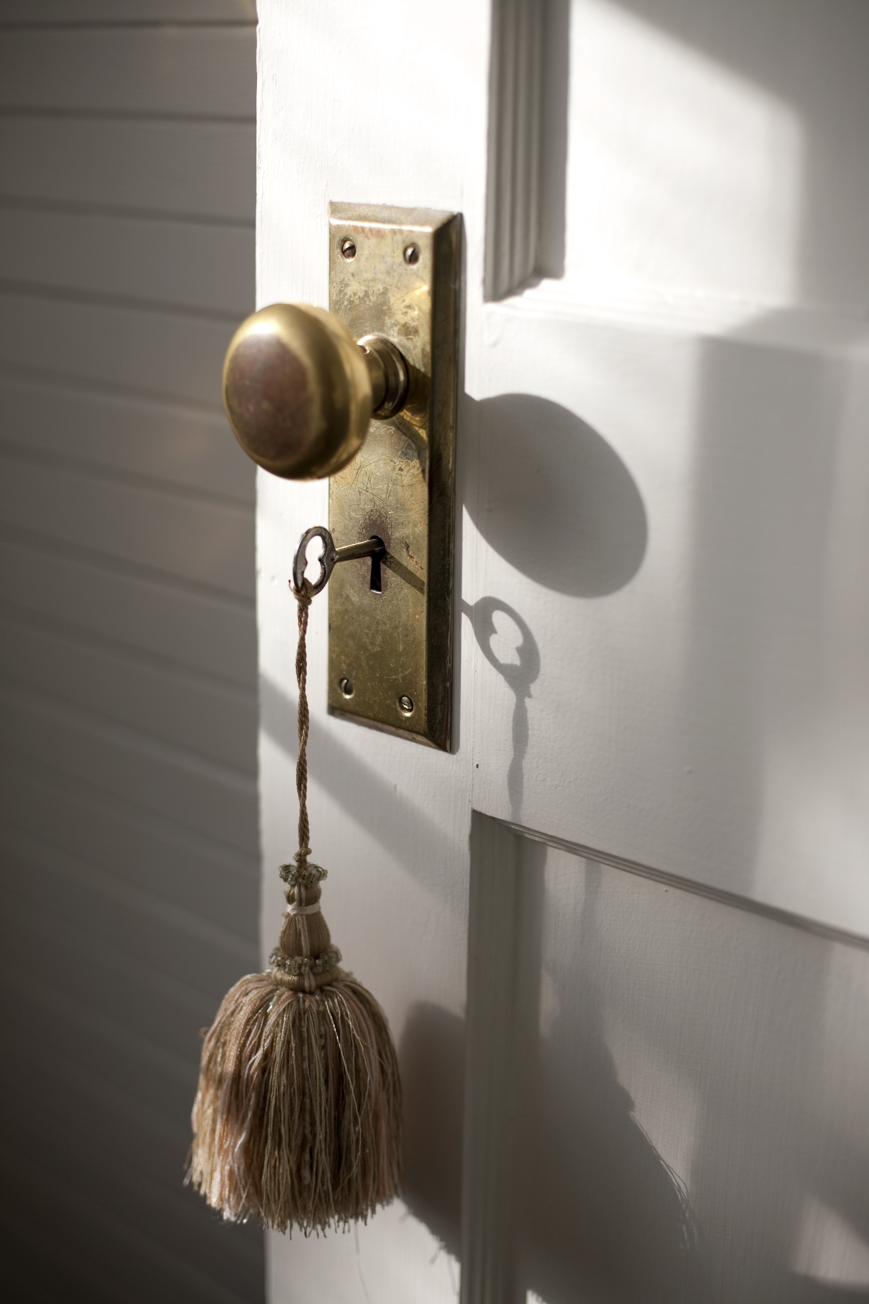 Close of door knob and key with tassel