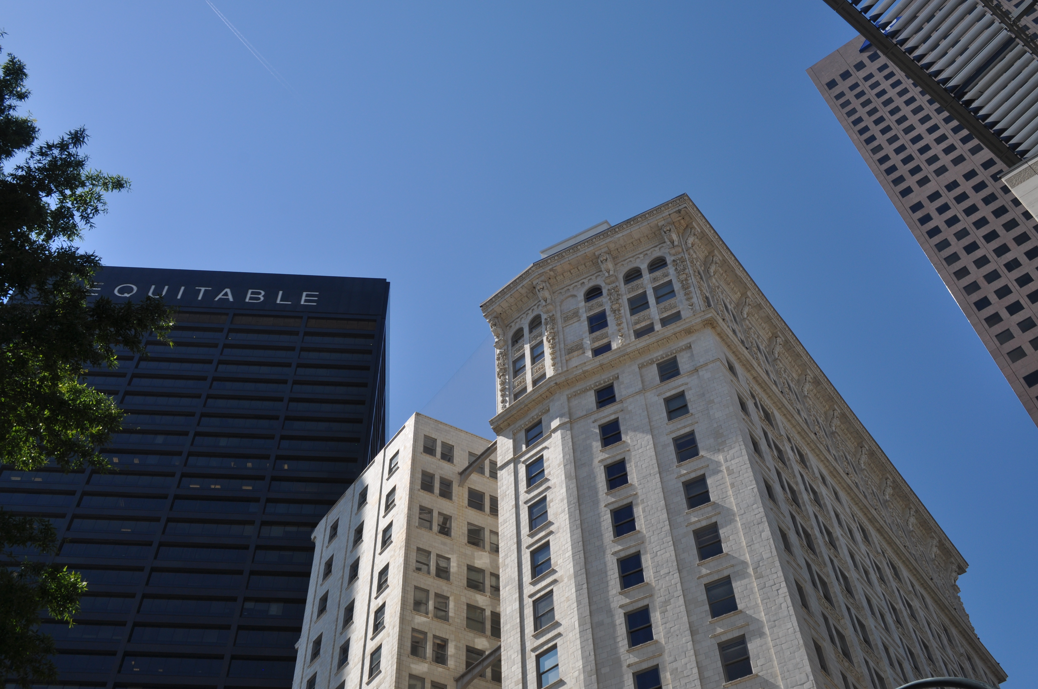 A photo of the ornate 17-story white marble building.