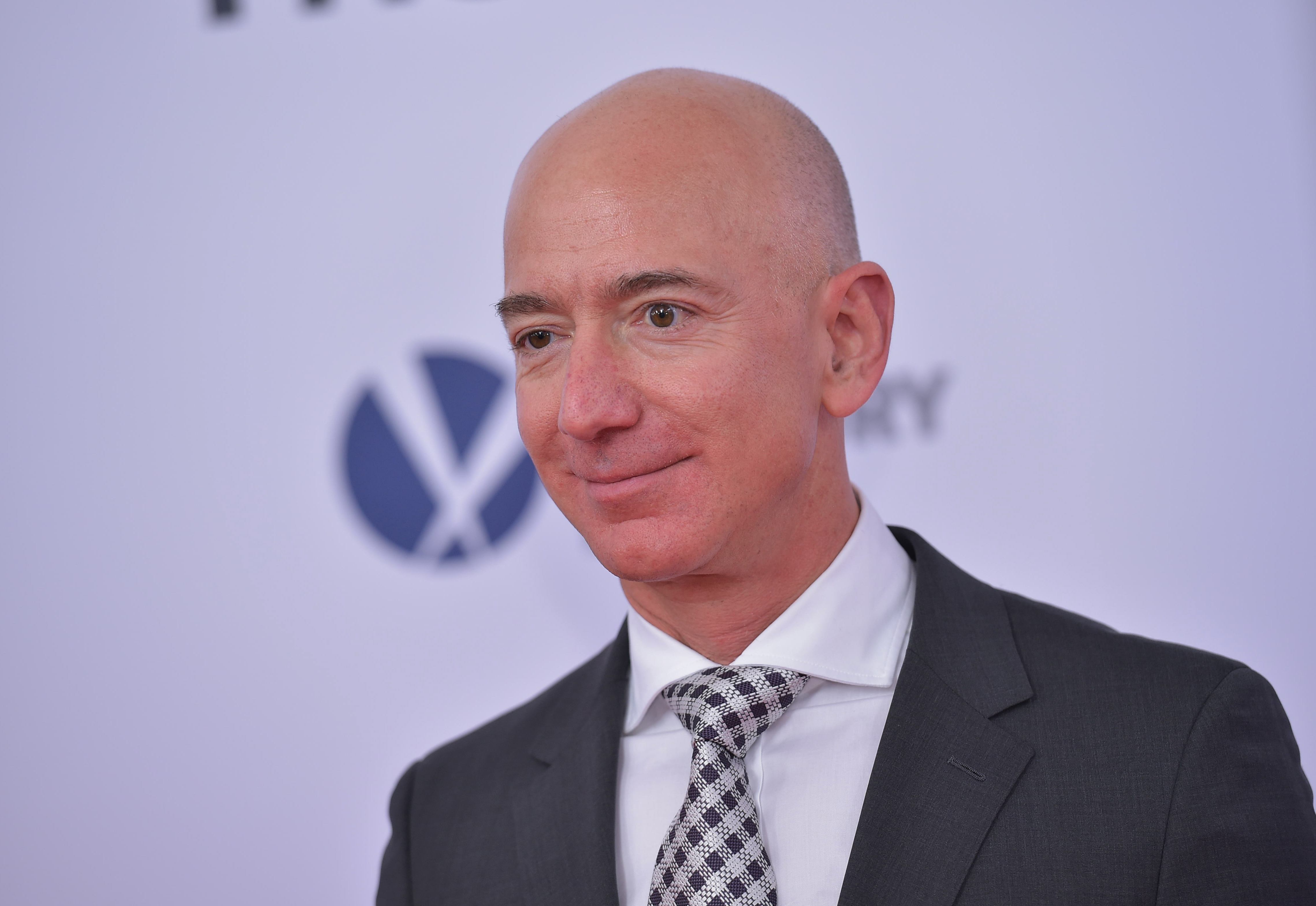 Amazon CEO Jeff Bezos stands for photos outside the premiere of 'The Post' on December 14, 2017, in Washington, DC.