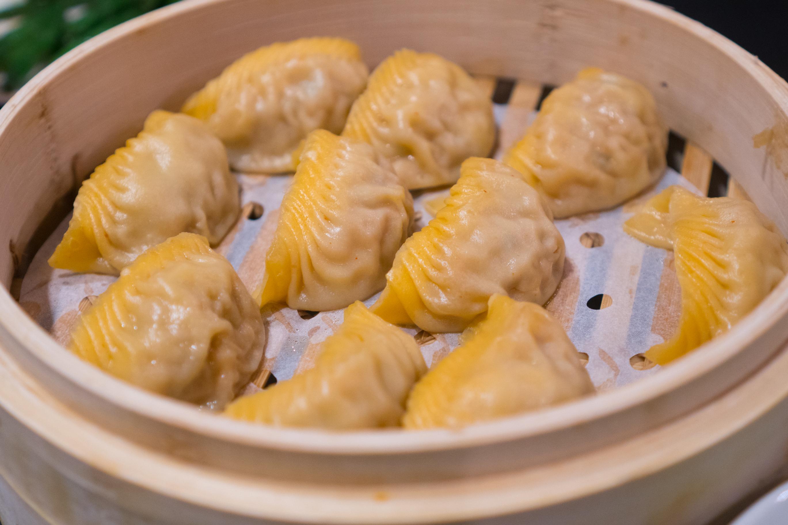 Kimchi dumplings sit in a steamer basket at Din Tai Fung