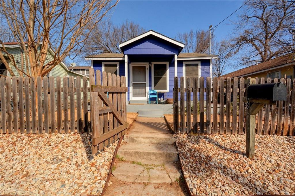 Small frame house painted blue with white trim