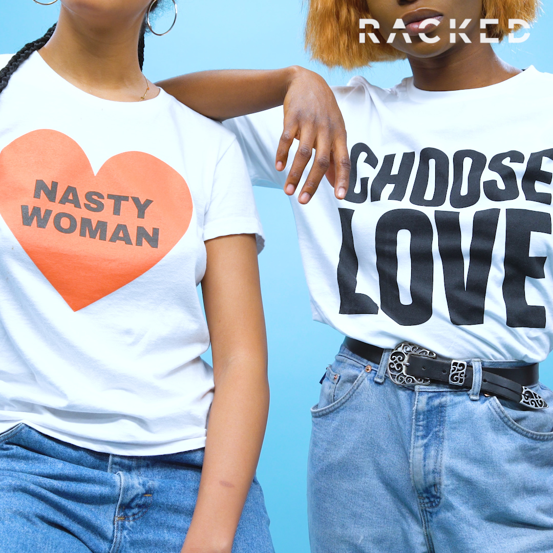 """Closeup on two slogan T-shirts reading """"Nasty Woman"""" and """"Choose Love"""""""