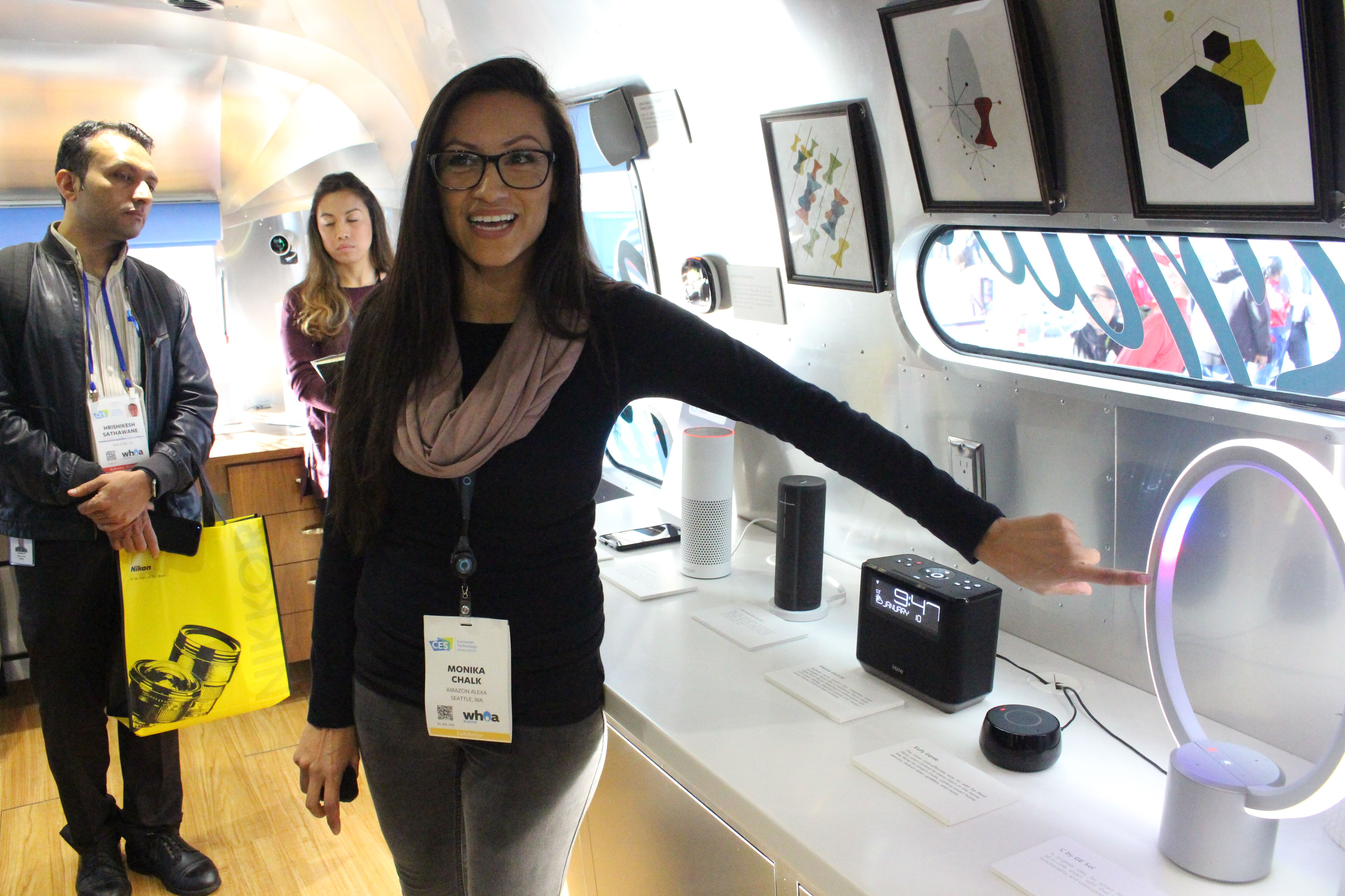 Monika Chalk of the Amazon Alexa team demonstrates an array of devices infused the company's artificial intelligence in a Roadshow trailer parked at the Consumer Electronics Show in Las Vegas, January 10, 2018.
