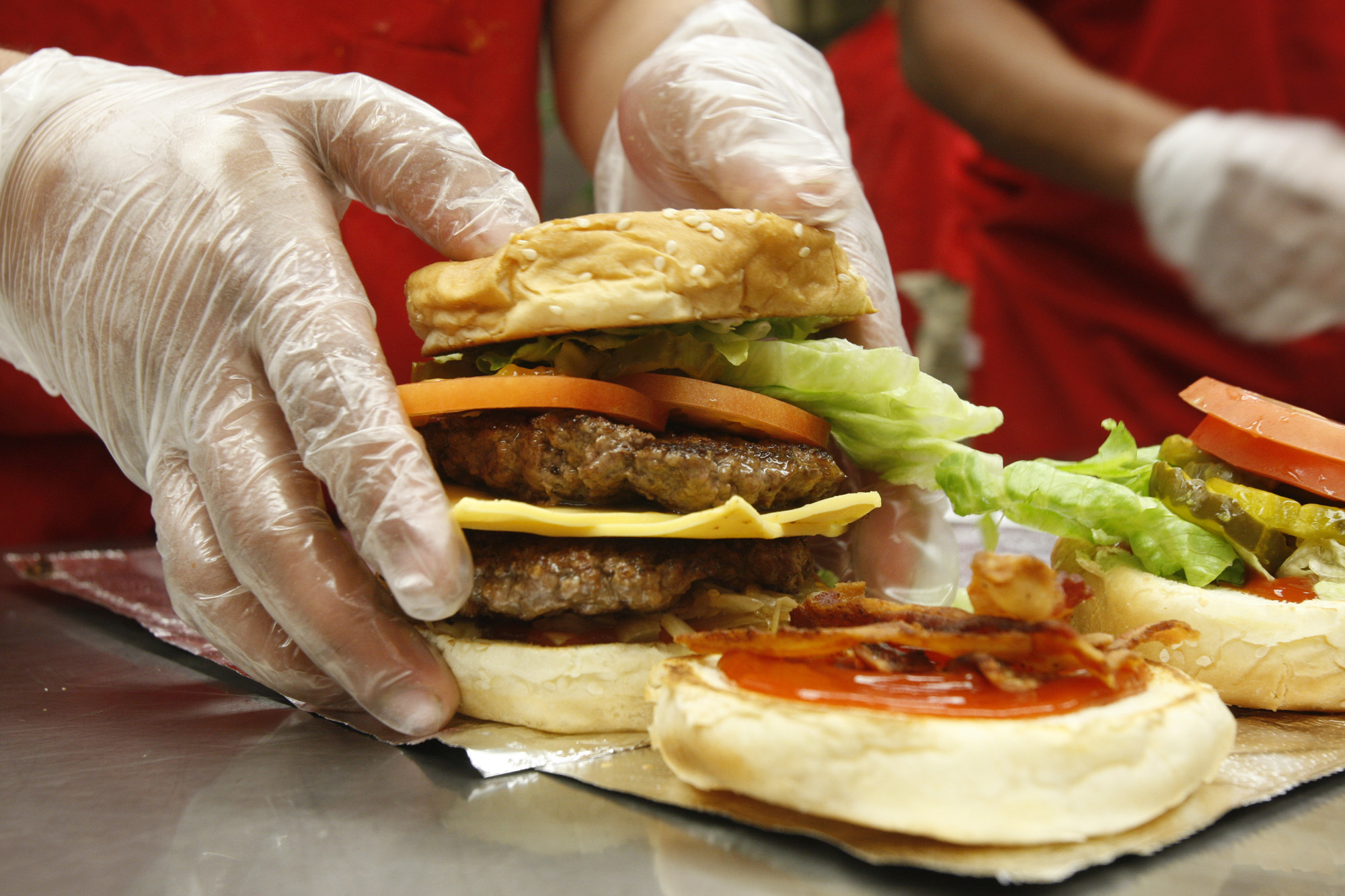 Hamburgers are made at Five Guys Burgers and Fries, located in Valencia, on March 16, 2011. Five Gu