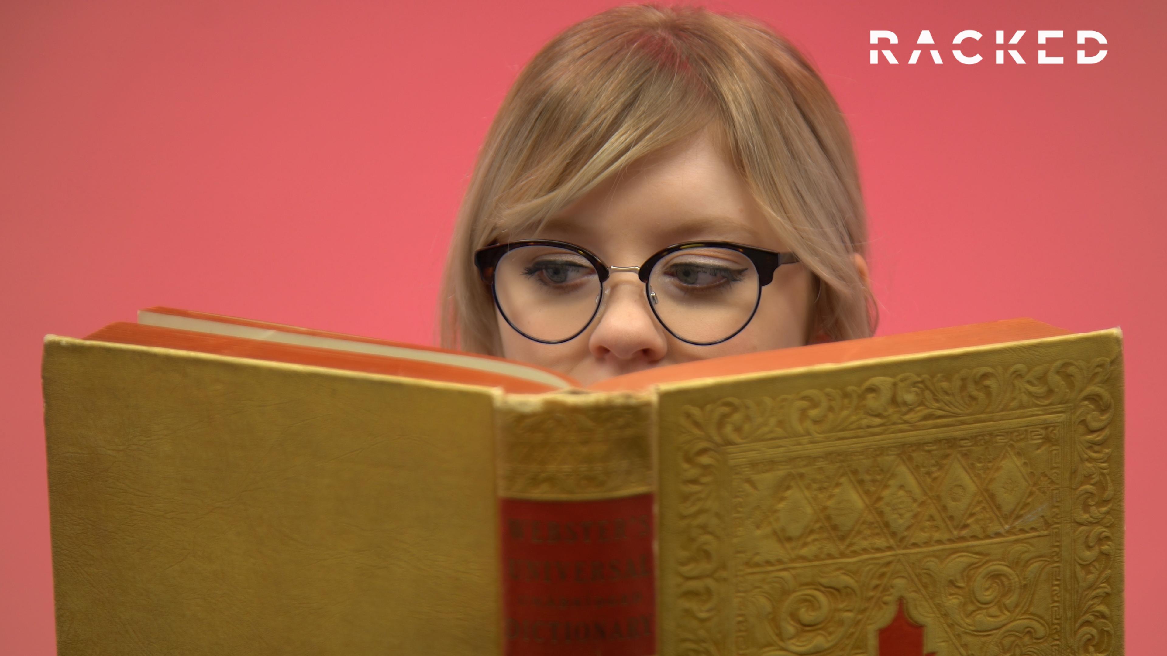 Rebecca Jennings in glasses reading a book