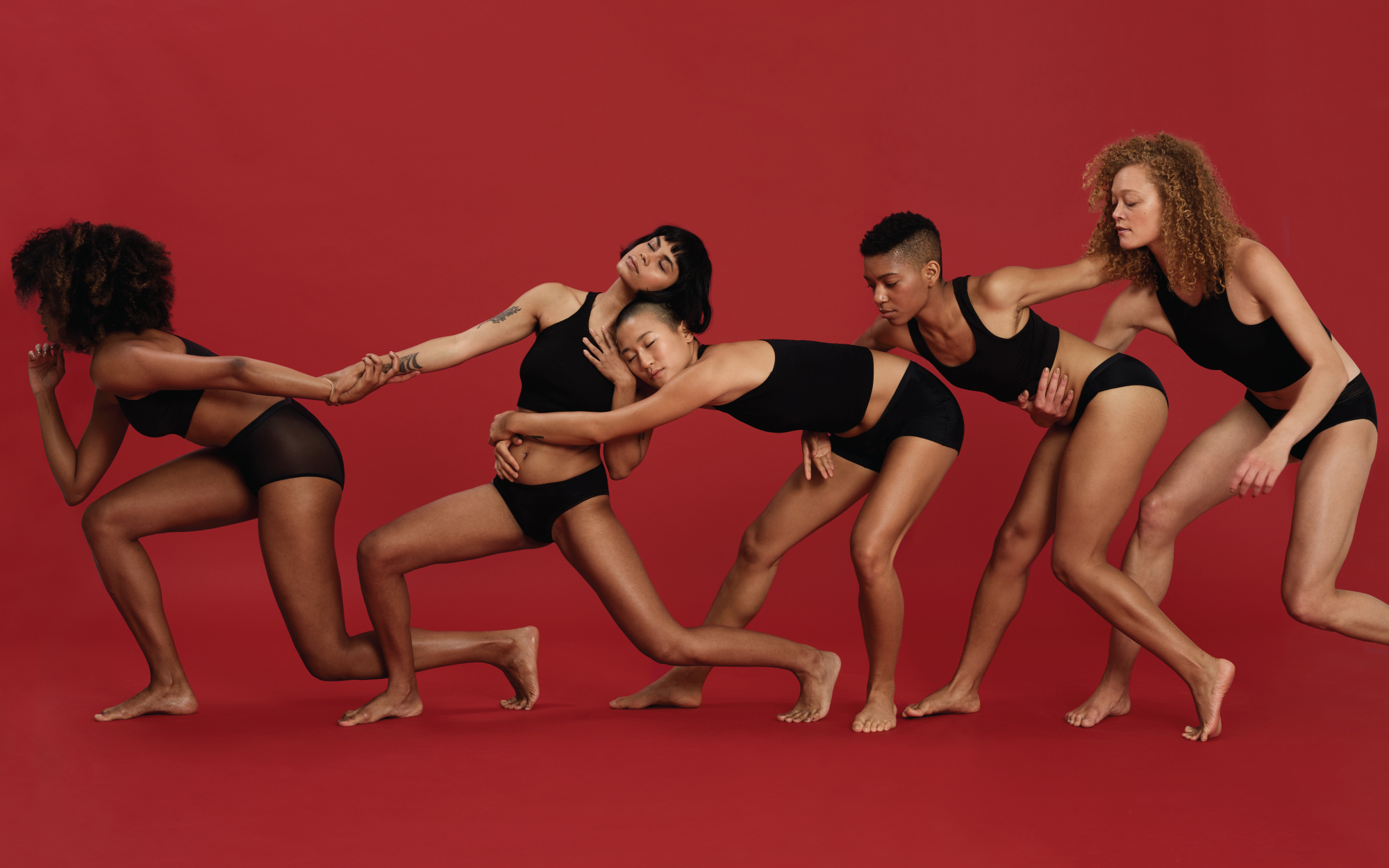 """An image of five women in Thinx underwear from the brand's """"Fearless Bleeding"""" campaign."""