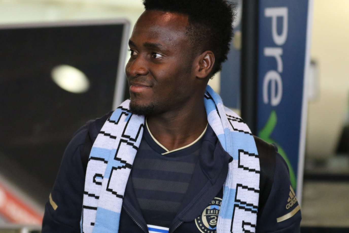 David Accam gives Philadelphia Union fans a sneak peek at the club's new jersey at the airport.