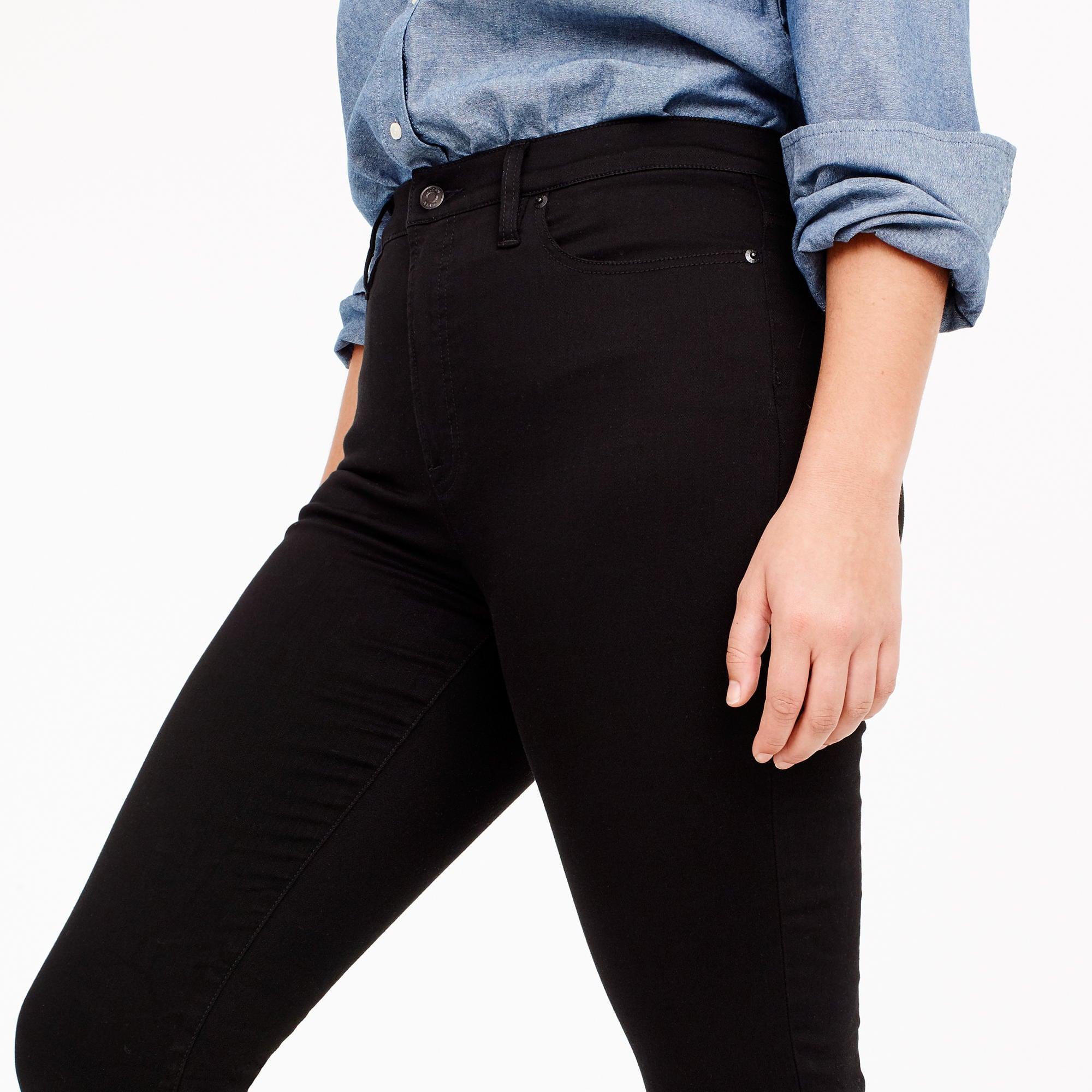 A model wearing black jeans