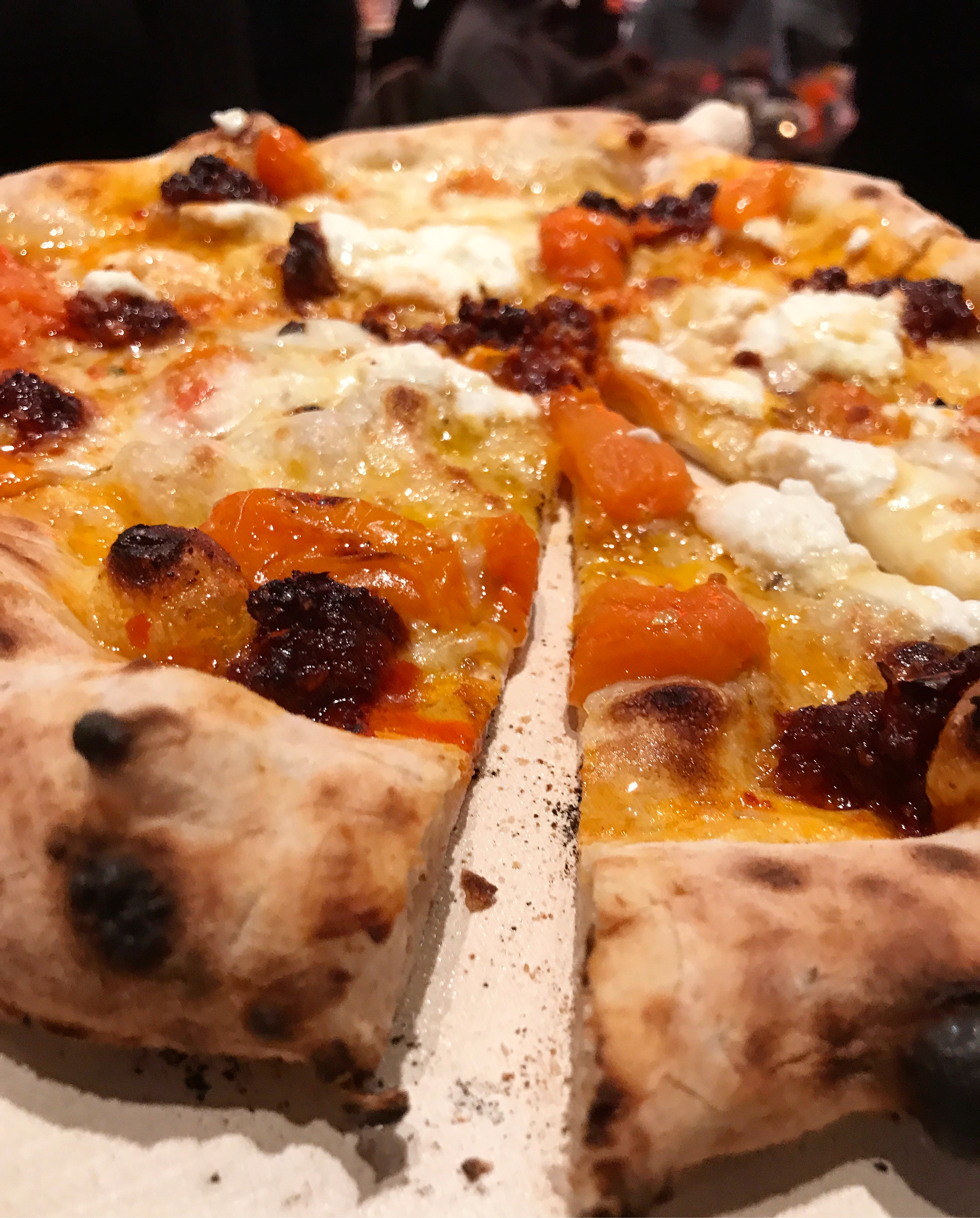 Mona Lizza with spicy 'Nduja' soft salami, ricotta, slow-roasted yellow tomatoes, and honey