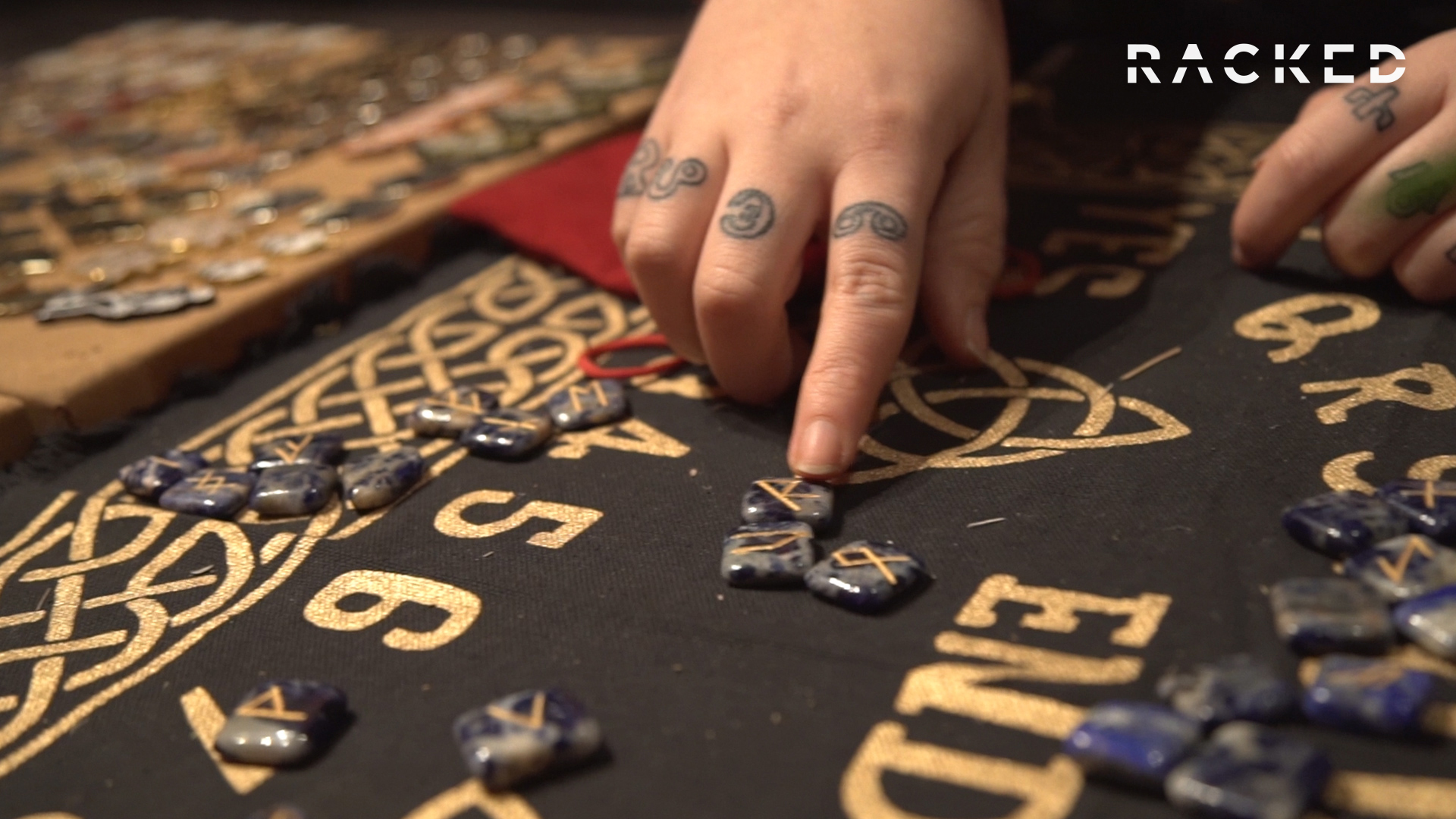 Closeup on tattooed hand with stones