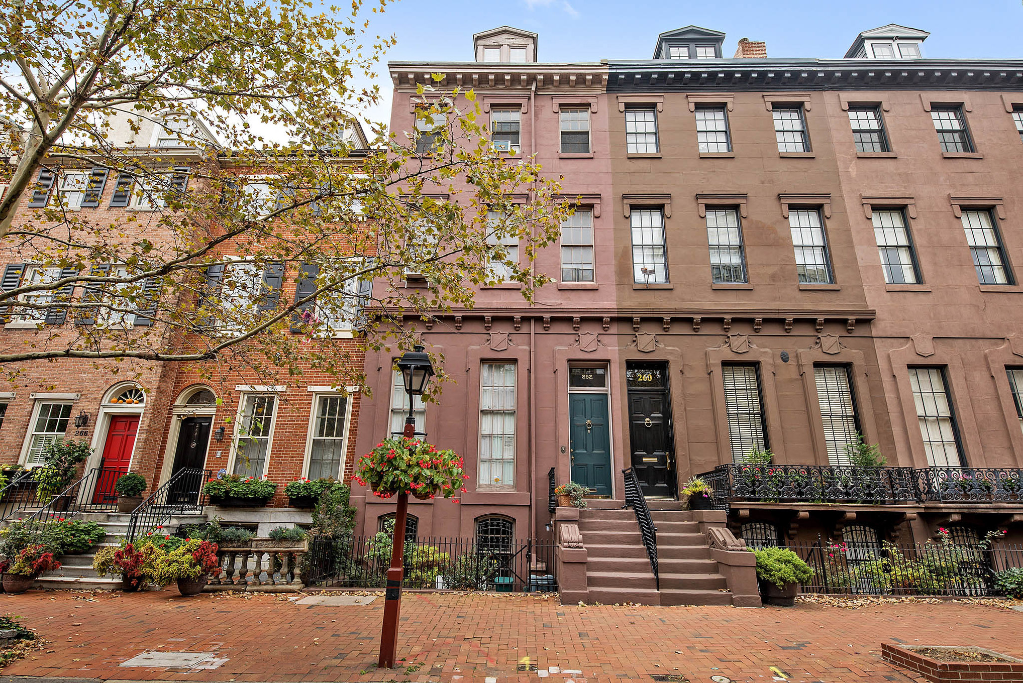 A series of rowhomes, including three tall brownstones in Philly's Society Hill neighborhood.