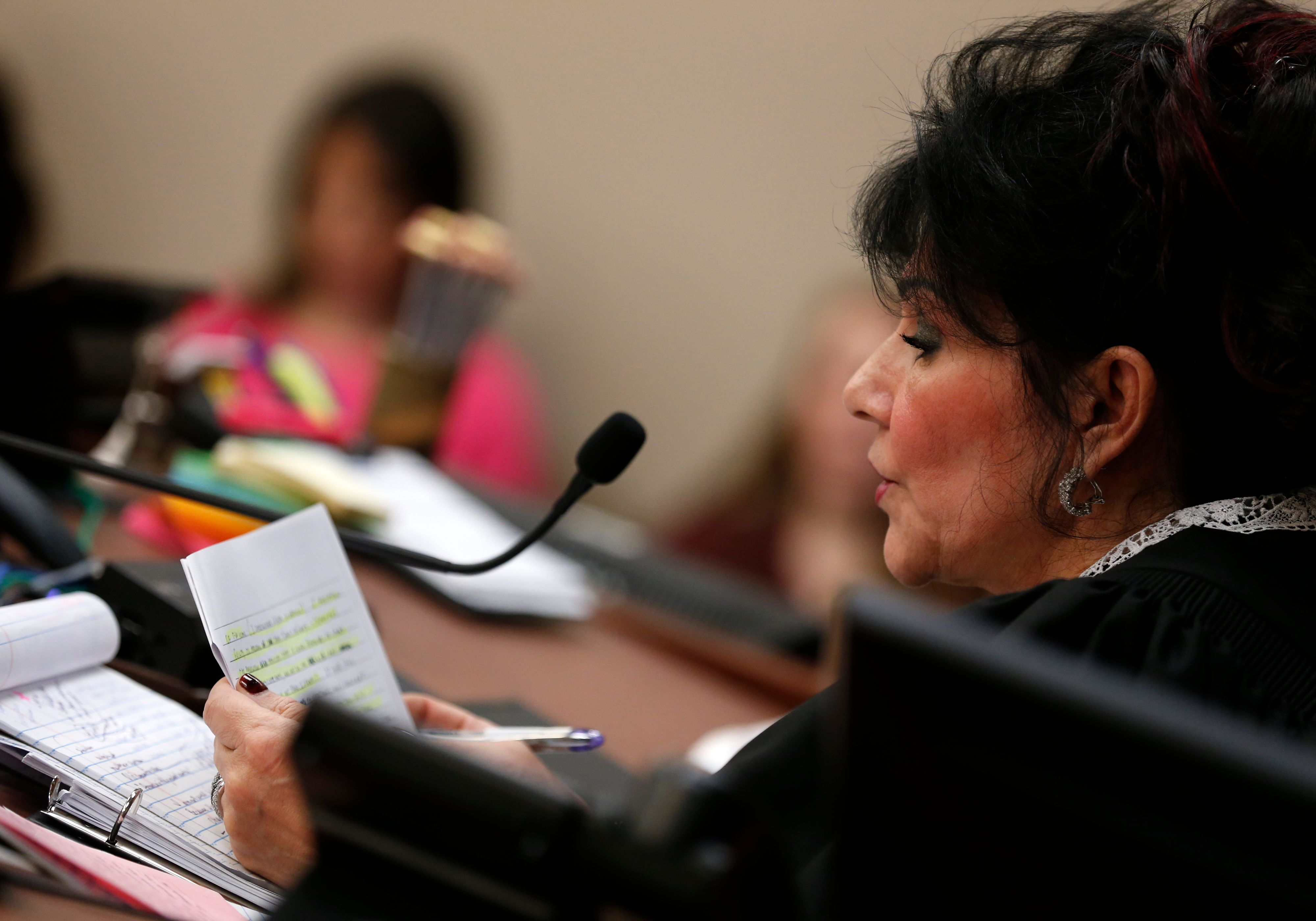 Judge Rosemarie Aquilina reads a letter from former Michigan State University and USA Gymnastics doctor Larry Nassar during the sentencing phase of his trial, January 24.